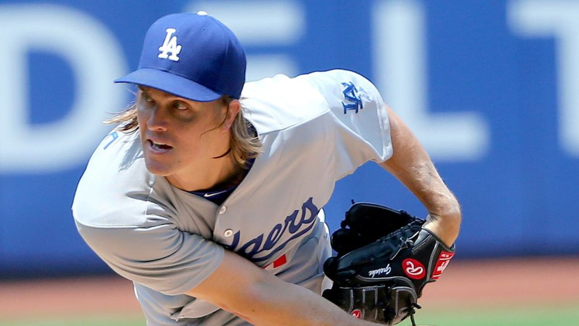 Jul 26, 2015; New York City, NY, USA; Los Angeles Dodgers starting pitcher Zack Greinke (21) pitches during the first inning against the New York Mets at Citi Field. Mandatory Credit: Anthony Gruppuso-USA TODAY Sports