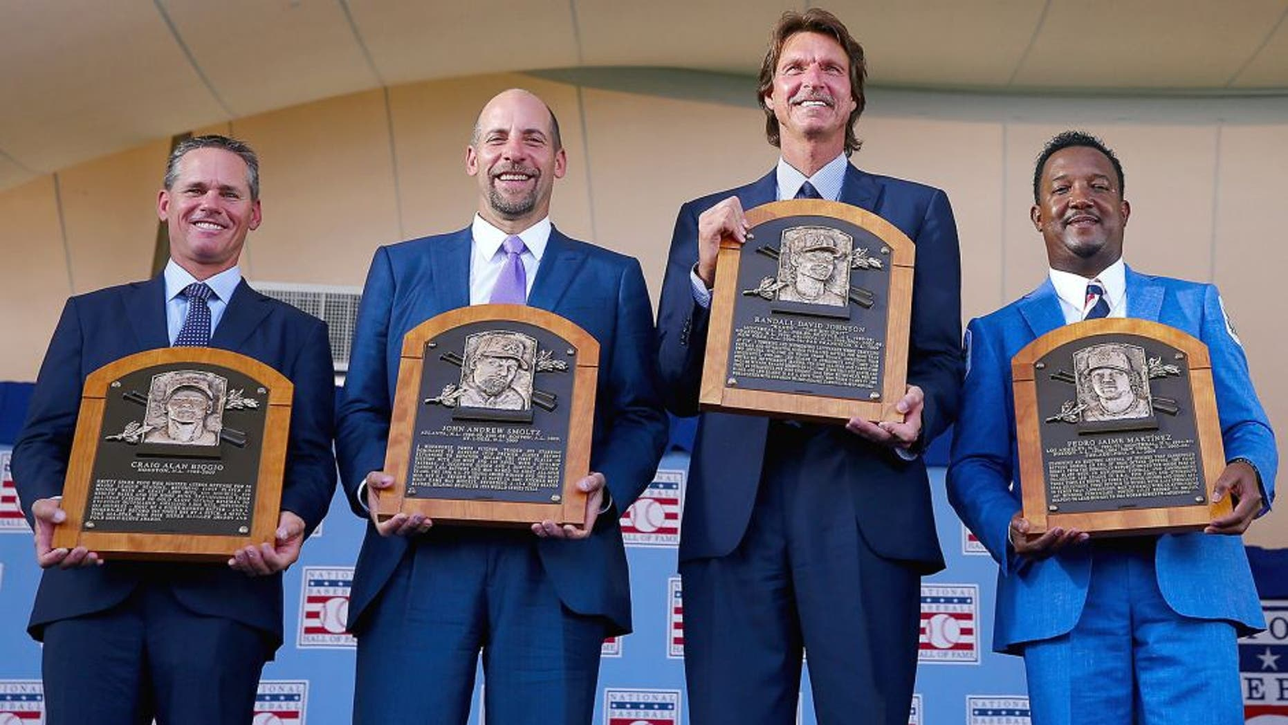 COOPERSTOWN, NY - JULY 26: 2015 Inductees Craig Biggio,John Smoltz,Randy Johnson and Pedro Martinez pose with their plaques after the Induction Ceremony at National Baseball Hall of Fame on July 26, 2015 in Cooperstown, New York. (Photo by Elsa/Getty Images)