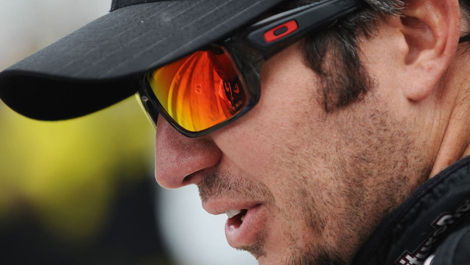 INDIANAPOLIS, IN - JULY 25: Martin Truex Jr., driver of the #78 Furniture Row/Visser Precision Chevrolet, sits on the grid during qualifying for the NASCAR Sprint Cup Series Crown Royal Presents the Jeff Kyle 400 at the Brickyard at Indianapolis Motor Speedway on July 25, 2015 in Indianapolis, Indiana. (Photo by Rainier Ehrhardt/NASCAR via Getty Images)