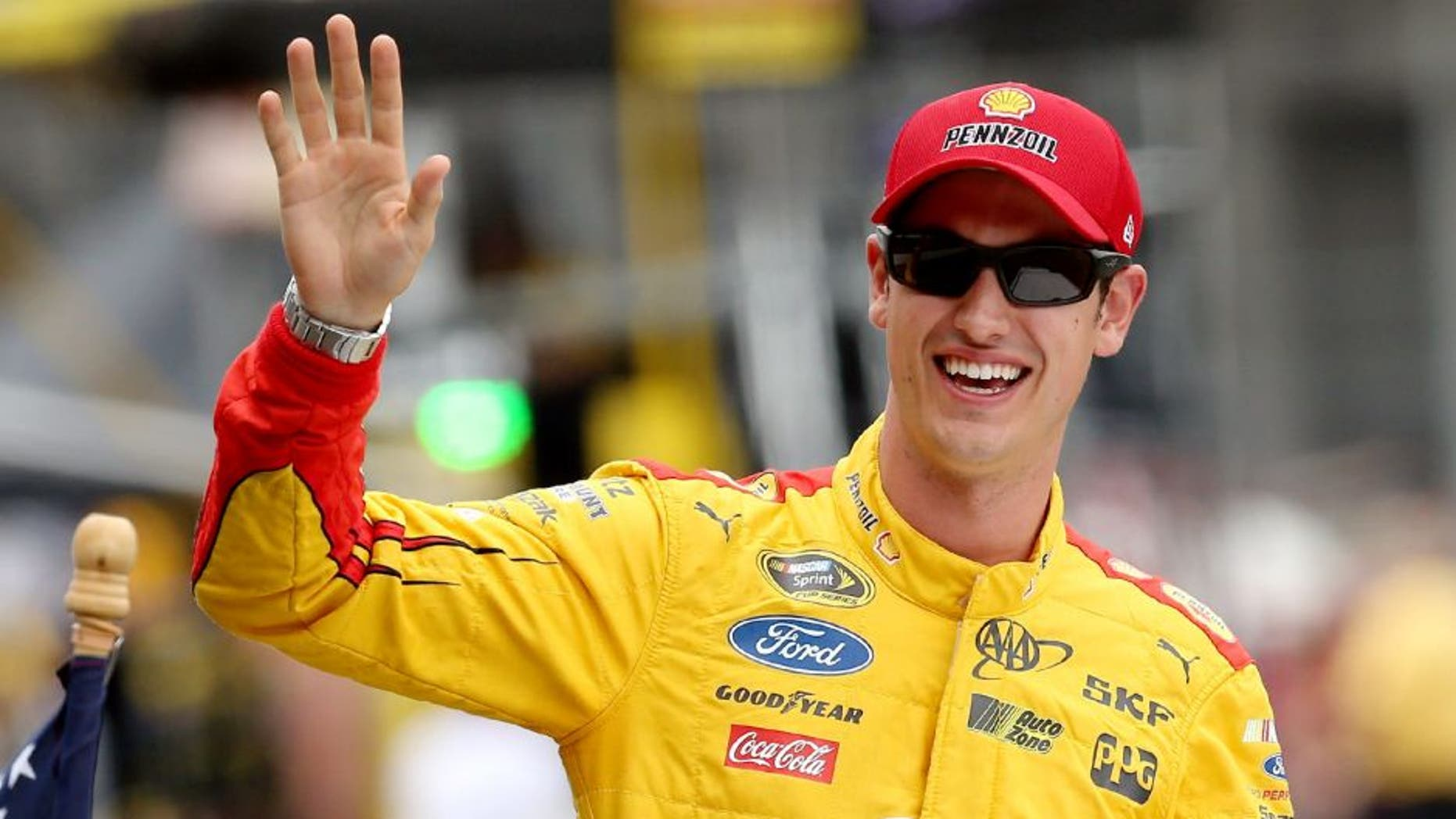 INDIANAPOLIS, IN - JULY 26: Joey Logano, driver of the #22 Shell Pennzoil Ford, waves prior to the NASCAR Sprint Cup Series Crown Royal Presents the Jeff Kyle 400 at the Brickyard at Indianapolis Motor Speedway on July 26, 2015 in Indianapolis, Indiana. (Photo by Andy Lyons/Getty Images)