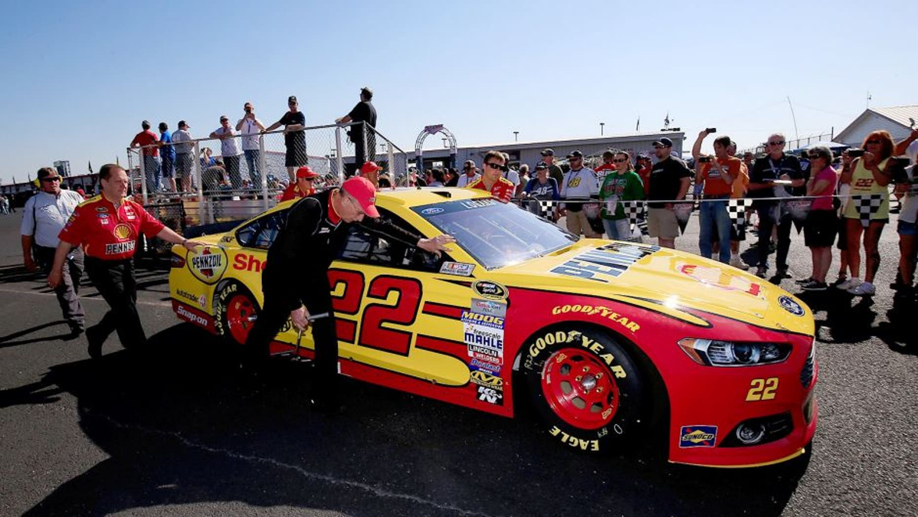 TALLADEGA, AL - MAY 03: Crew members push the car of Joey Logano, driver of the #22 Shell Pennzoil Ford, through the garage area prior to the NASCAR Sprint Cup Series GEICO 500 at Talladega Superspeedway on May 3, 2015 in Talladega, Alabama. (Photo by Chris Trotman/NASCAR via Getty Images)