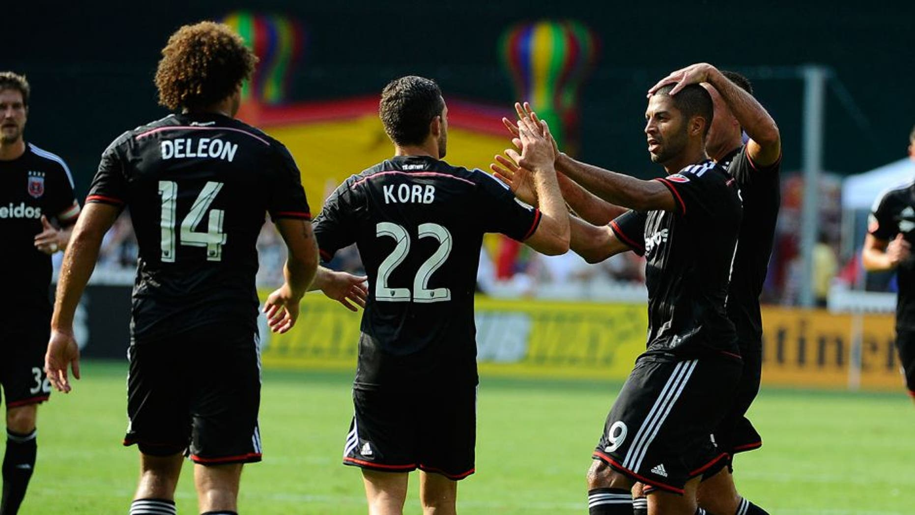 Jul 26, 2015; Washington, DC, USA; D.C. United forward Alvaro Saborio (9) is congratulated by teammates after scoring a goal against the Philadelphia Union during the first half at Robert F. Kennedy Memorial. Mandatory Credit: Brad Mills-USA TODAY Sports