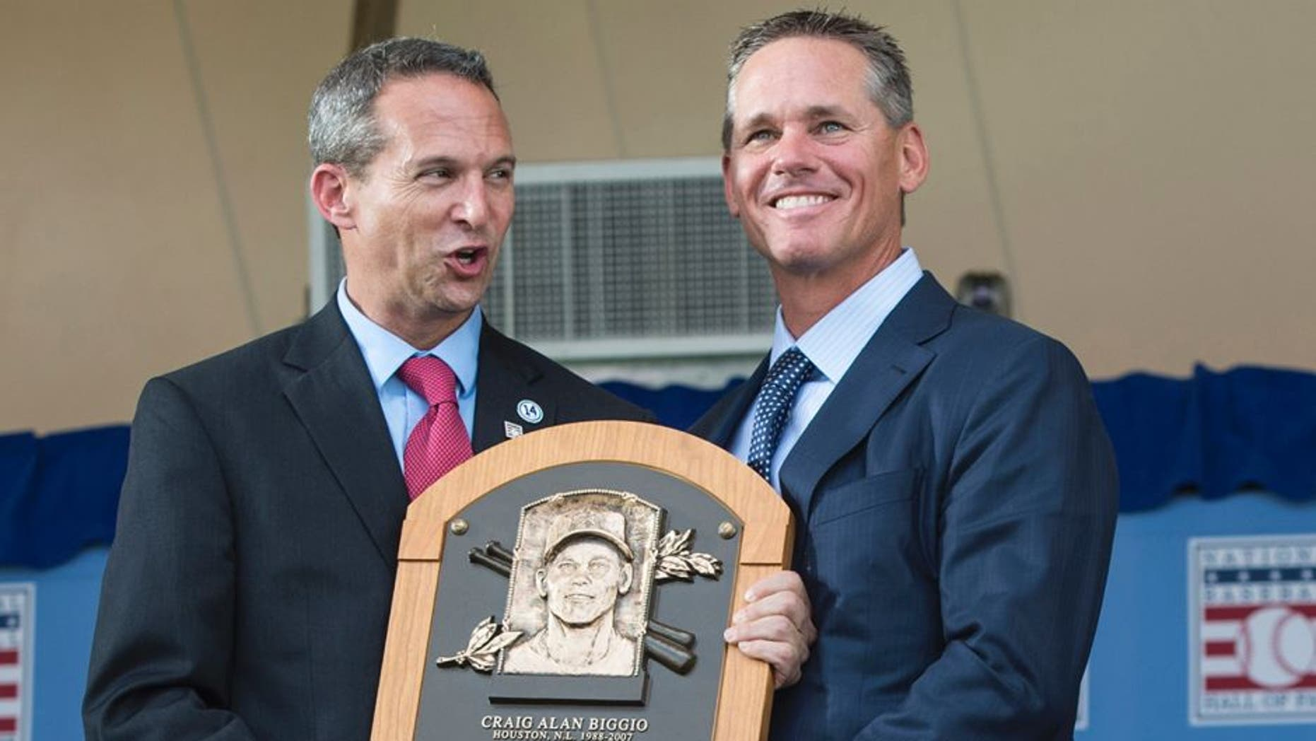 Jul 26, 2015; Cooperstown, NY, USA; Hall of Fame President Jeff Idelson (L) presents Hall of Fame Inductee Craig Biggio (R) with his Hall of Fame Plague during the Hall of Fame Induction Ceremonies at Clark Sports Center. Mandatory Credit: Gregory J. Fisher-USA TODAY Sports