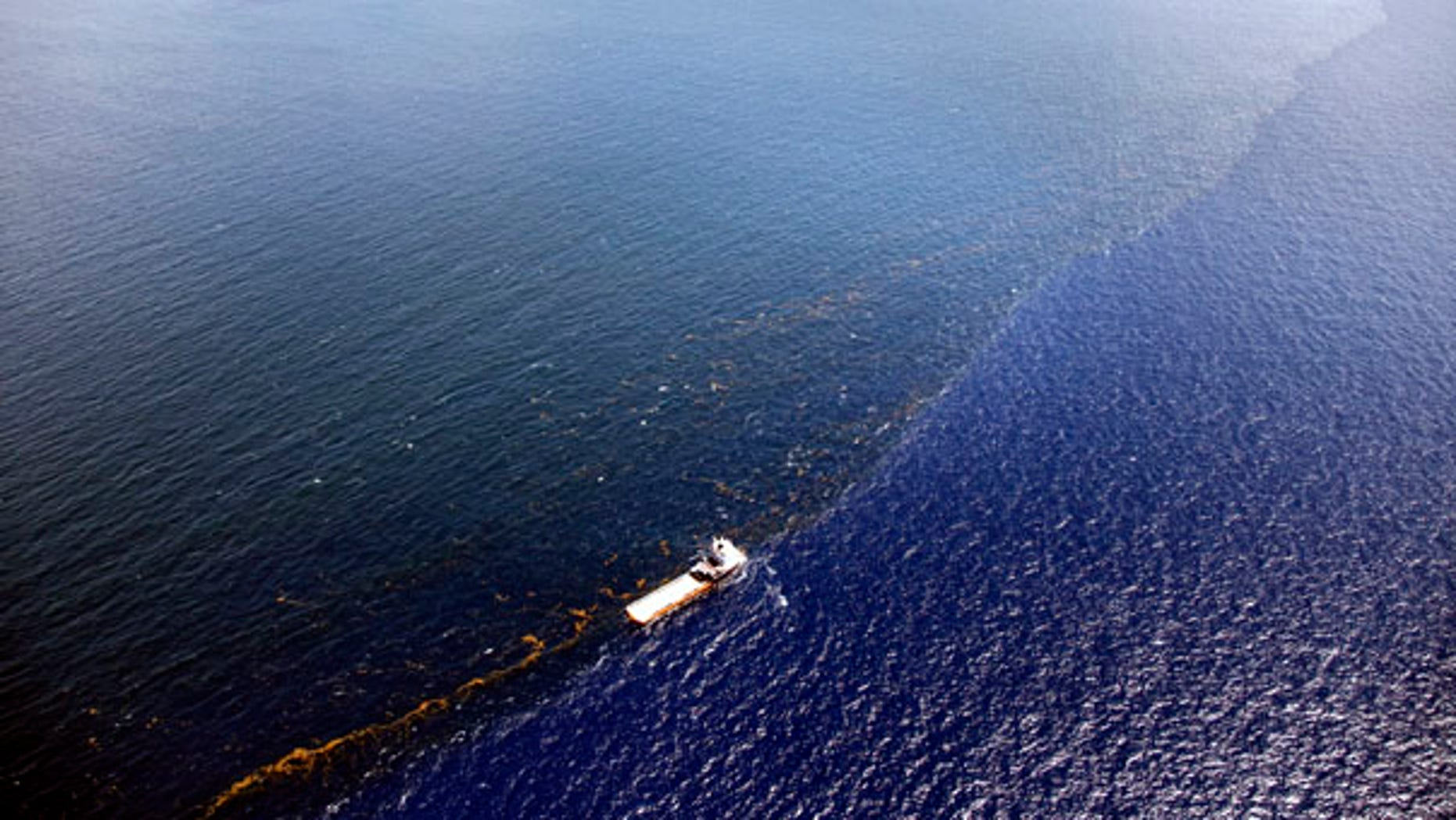 July 26: A response vessel is seen along a line of emulsified oil between the Deepwater Horizon oil spill site and the Louisiana coast in the Gulf of Mexico.