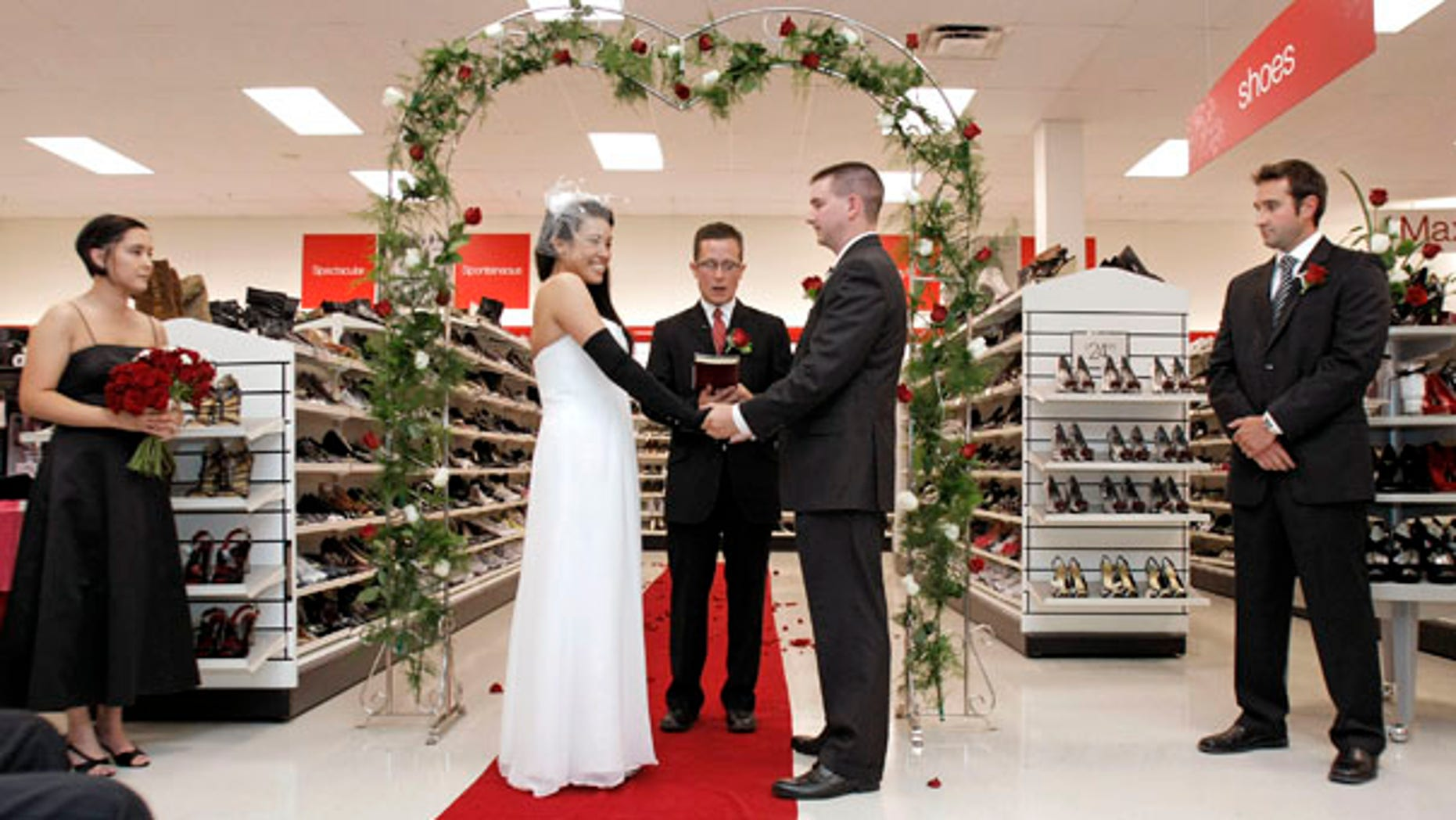 July 24: Self-proclaimed 'Maxxinista' Lisa Satayut and her new husband, Drew Ellis exchange vows in their local T.J.Maxx store in Mt. Pleasant, Mich. The couple chose to wed at the retailer because the bride calls it her 'happy place.'