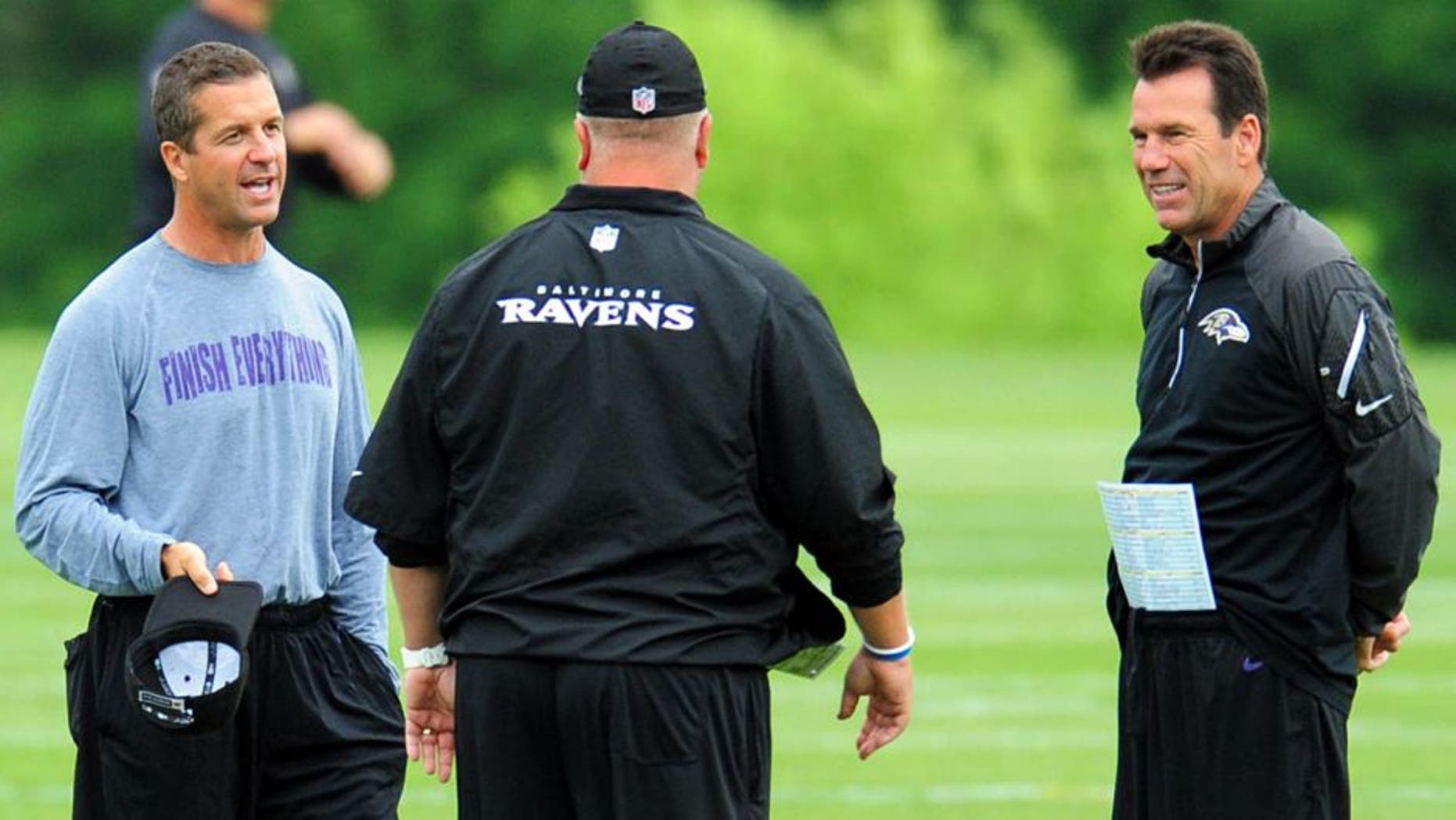 Jun 19, 2014; Baltimore, MD, USA; Baltimore Ravens head coach John Harbaugh (left) and offensive coordinator Gary Kubiak (right) talk during minicamp at the Under Armour Performance Center. Mandatory Credit: Evan Habeeb-USA TODAY Sports