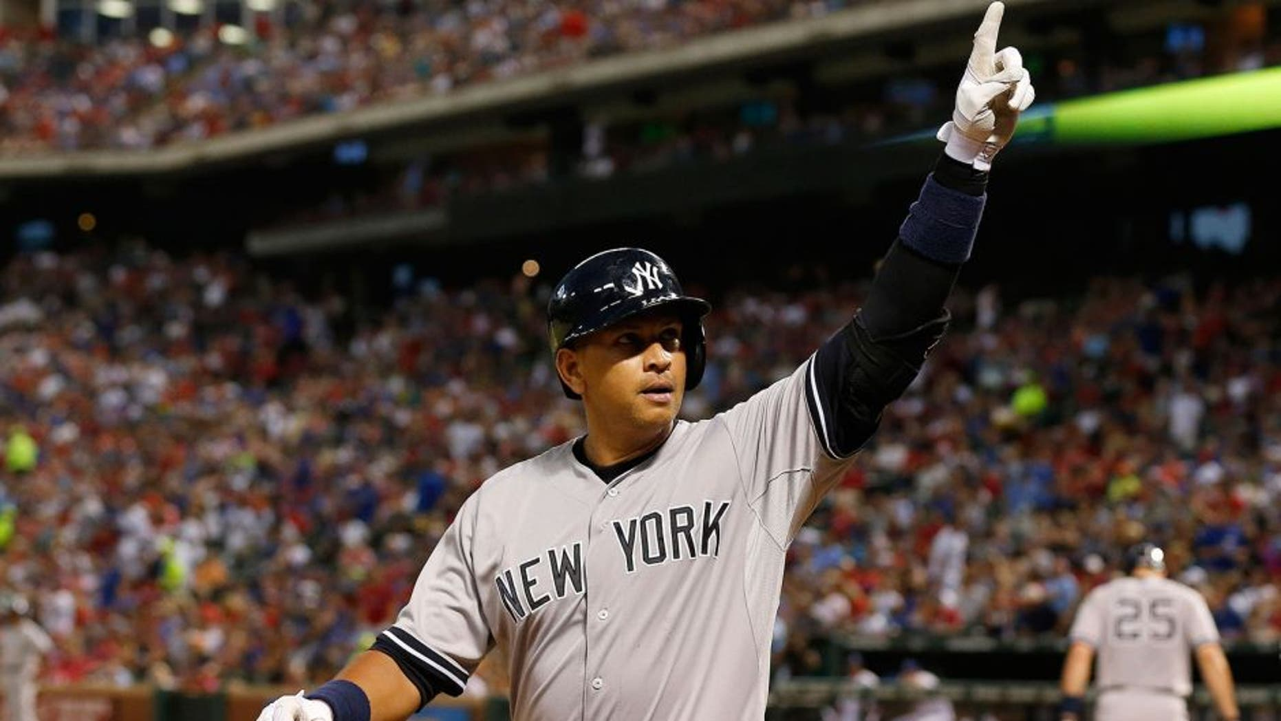 Jul 27, 2015; Arlington, TX, USA; New York Yankees designated hitter Alex Rodriguez (13) celebrates a solo home run in the sixth inning against the Texas Rangers at Globe Life Park in Arlington. Mandatory Credit: Matthew Emmons-USA TODAY Sports
