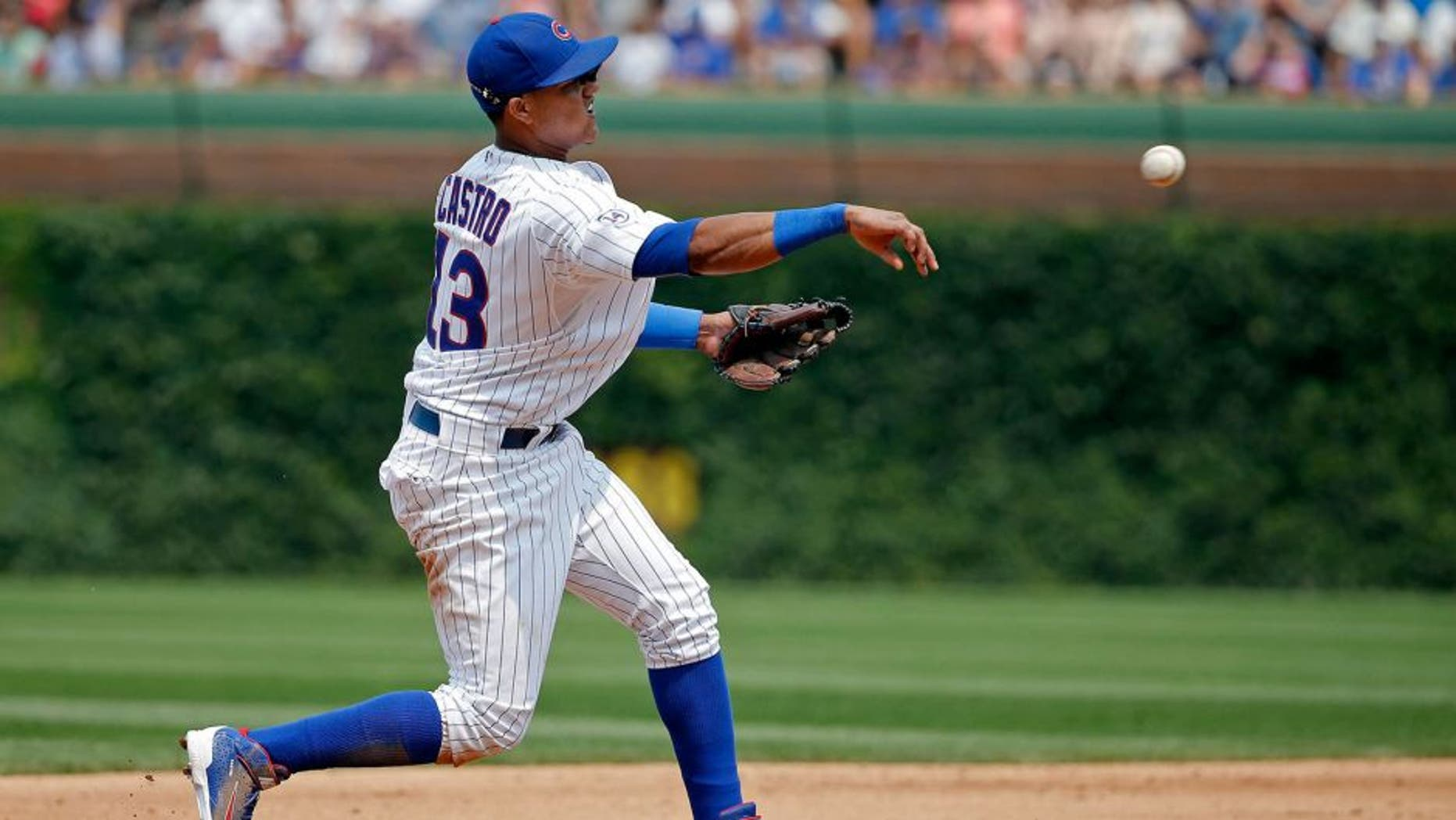 CHICAGO, IL - JULY 05: Starlin Castro #13 of the Chicago Cubs throws to first base for the out against the Miami Marlins during the fifth inning at Wrigley Field on July 5, 2015 in Chicago, Illinois. (Photo by Jon Durr/Getty Images)