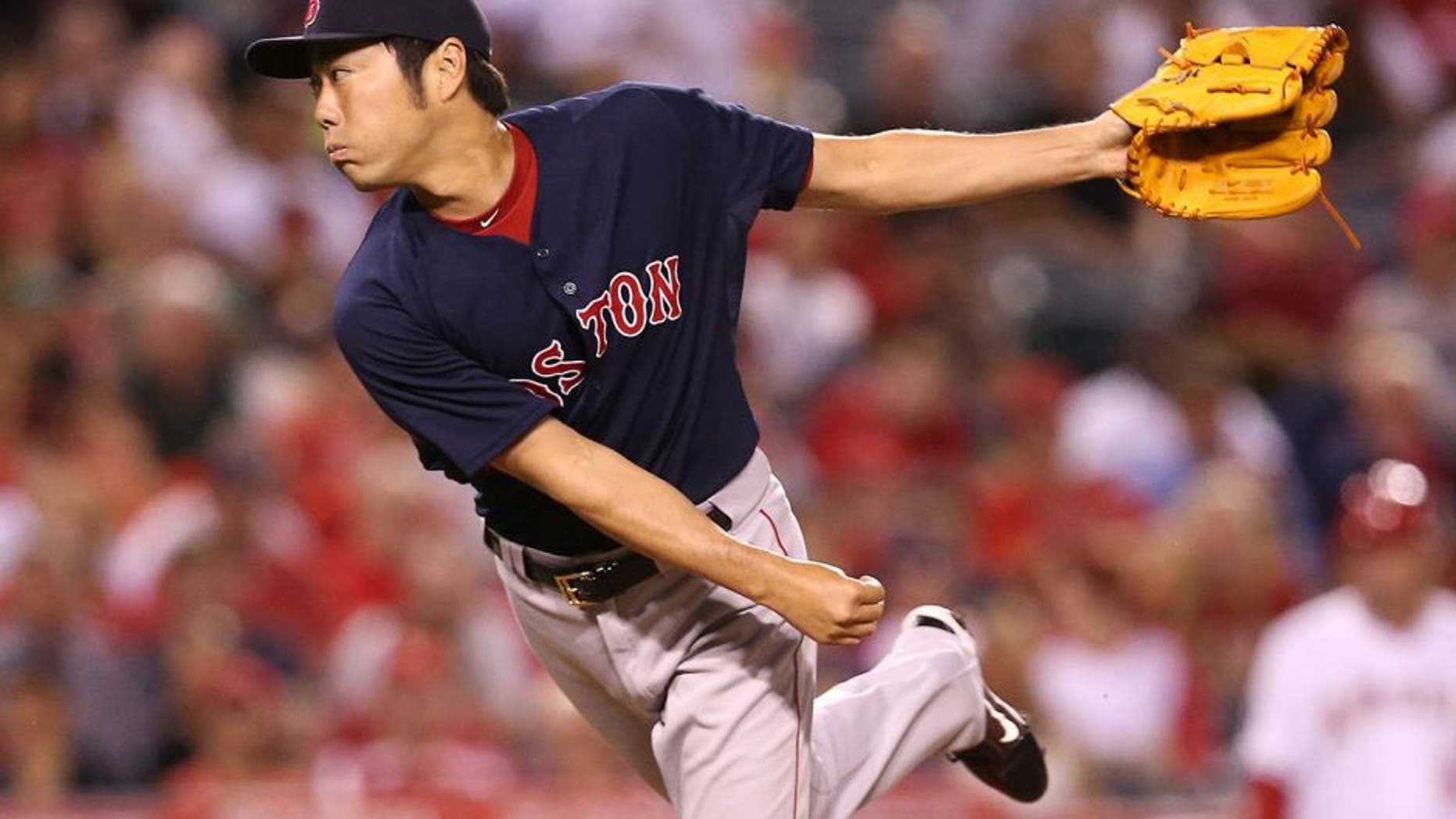 ANAHEIM, CA - JULY 17: Closer Koji Uehara#19 of the Boston Red Sox throws a pitch in the ninth inning the Los Angeles Angels of Anaheim at Angel Stadium of Anaheim on July 17, 2015 in Anaheim, California. The Angels won 1-0. (Photo by Stephen Dunn/Getty Images)