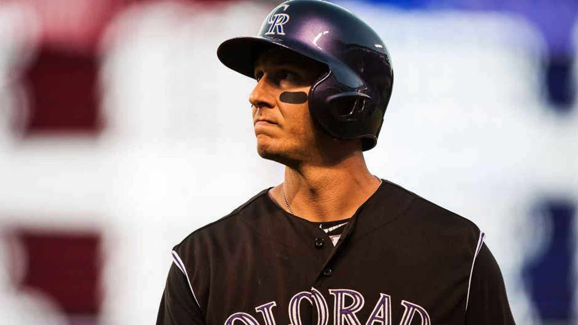DENVER, CO - JULY 25: Troy Tulowitzki #2 of the Colorado Rockies reacts after flying out in the seventh inning of a game against the Cincinnati Reds at Coors Field on July 25, 2015 in Denver, Colorado. (Photo by Dustin Bradford/Getty Images)