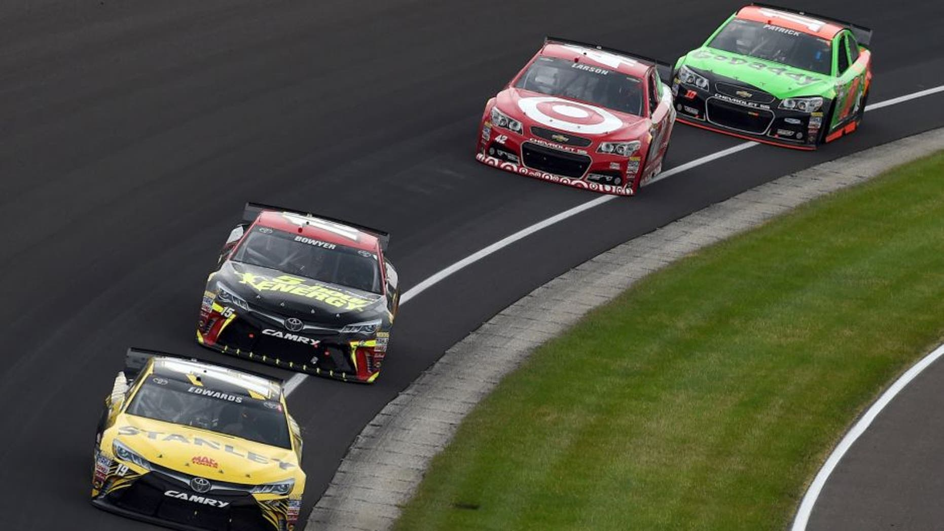 INDIANAPOLIS, IN - JULY 26: Carl Edwards, driver of the #19 Stanley Toyota, leads a pack of cars during the NASCAR Sprint Cup Series Crown Royal Presents the Jeff Kyle 400 at the Brickyard at Indianapolis Motor Speedway on July 26, 2015 in Indianapolis, Indiana. (Photo by Rainier Ehrhardt/NASCAR via Getty Images)