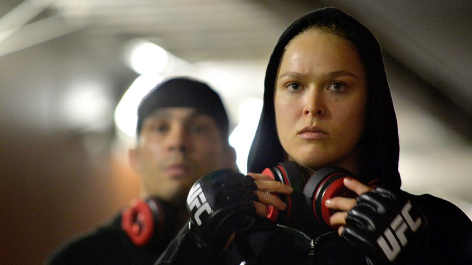 LOS ANGELES, CA - FEBRUARY 28: Ronda Rousey prepares to enter the Octagon in her UFC women's bantamweight championship bout against Cat Zingano during the UFC 184 event at Staples Center on February 28, 2015 in Los Angeles, California. (Photo by Mike Roach/Zuffa LLC/Zuffa LLC via Getty Images)