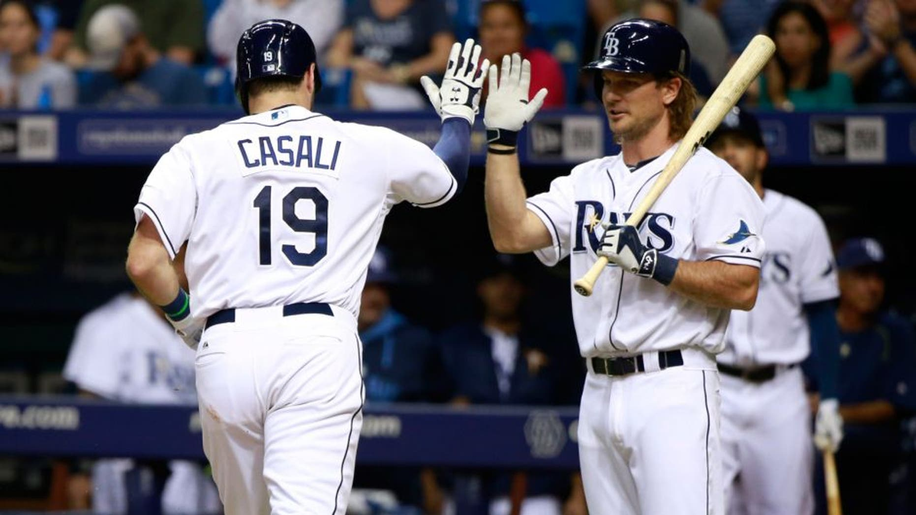 Jul 27, 2015; St. Petersburg, FL, USA; Tampa Bay Rays catcher Curt Casali (19) is congratulated by designated hitter John Jaso (28) after he hit a solo home run during the third inning against the Detroit Tigers at Tropicana Field. Mandatory Credit: Kim Klement-USA TODAY Sports