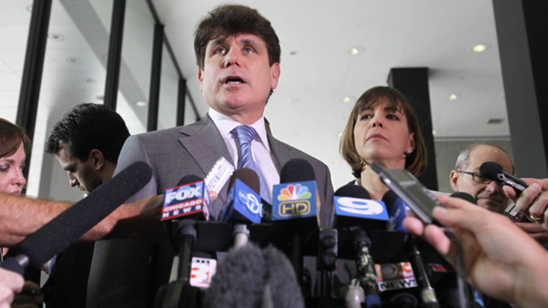 July 28: Former Illinois Gov. Rod Blagojevich speaks to the media at the Federal Court building in Chicago