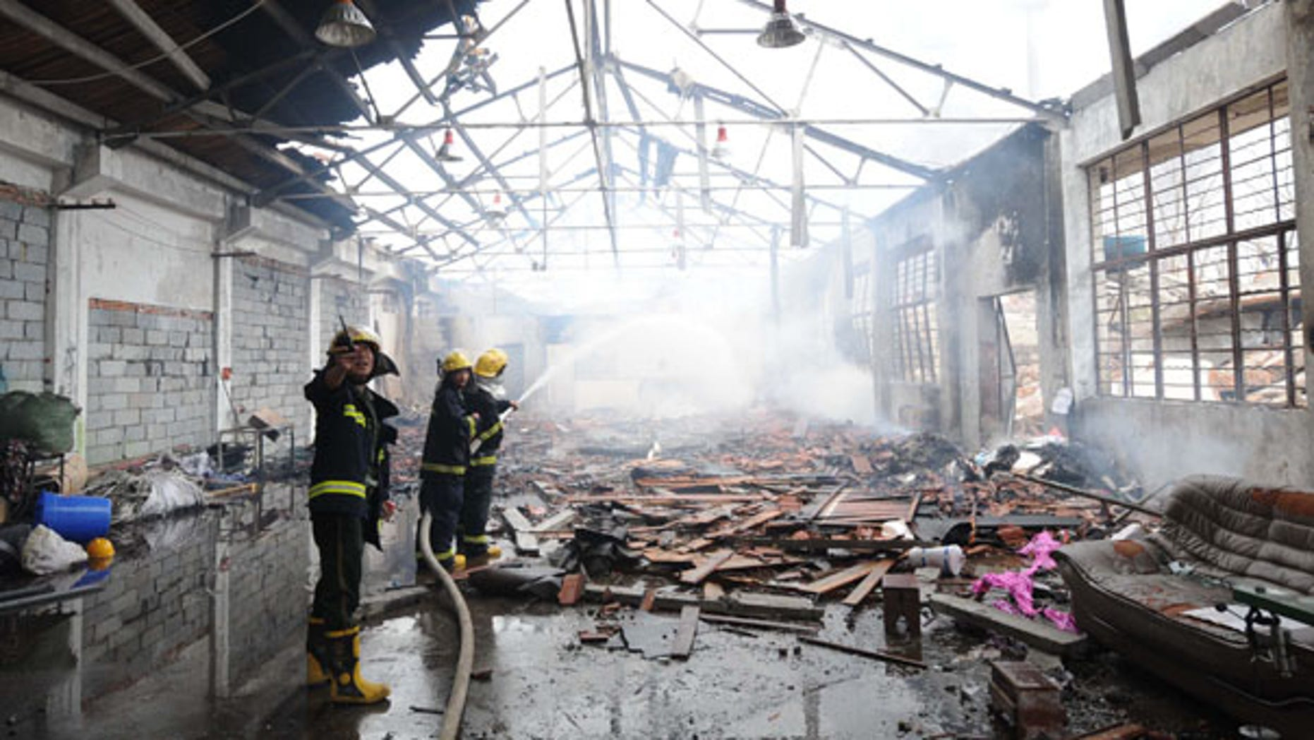 July 28: Firemen put out a fire in Nanjing after a powerful blast caused by a suspected gas leak rocked a plastics factory in eastern China, killing at least 12 people and seriously injuring 28.