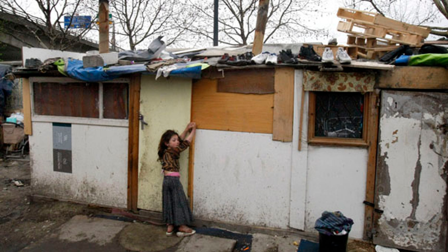 March 26: A young gypsy girl is seen in a makeshift camp in Saint Denis, a northern suburb of Paris.