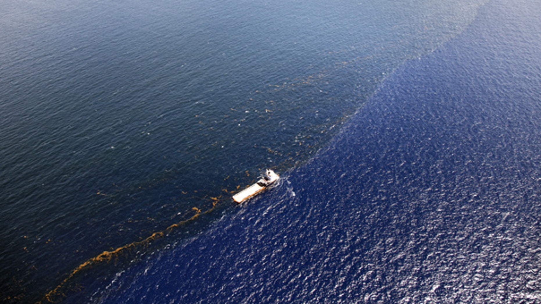July 26: A response vessel is seen along a line of emulsified oil between the Deepwater Horizon spill site and the Louisiana coast.