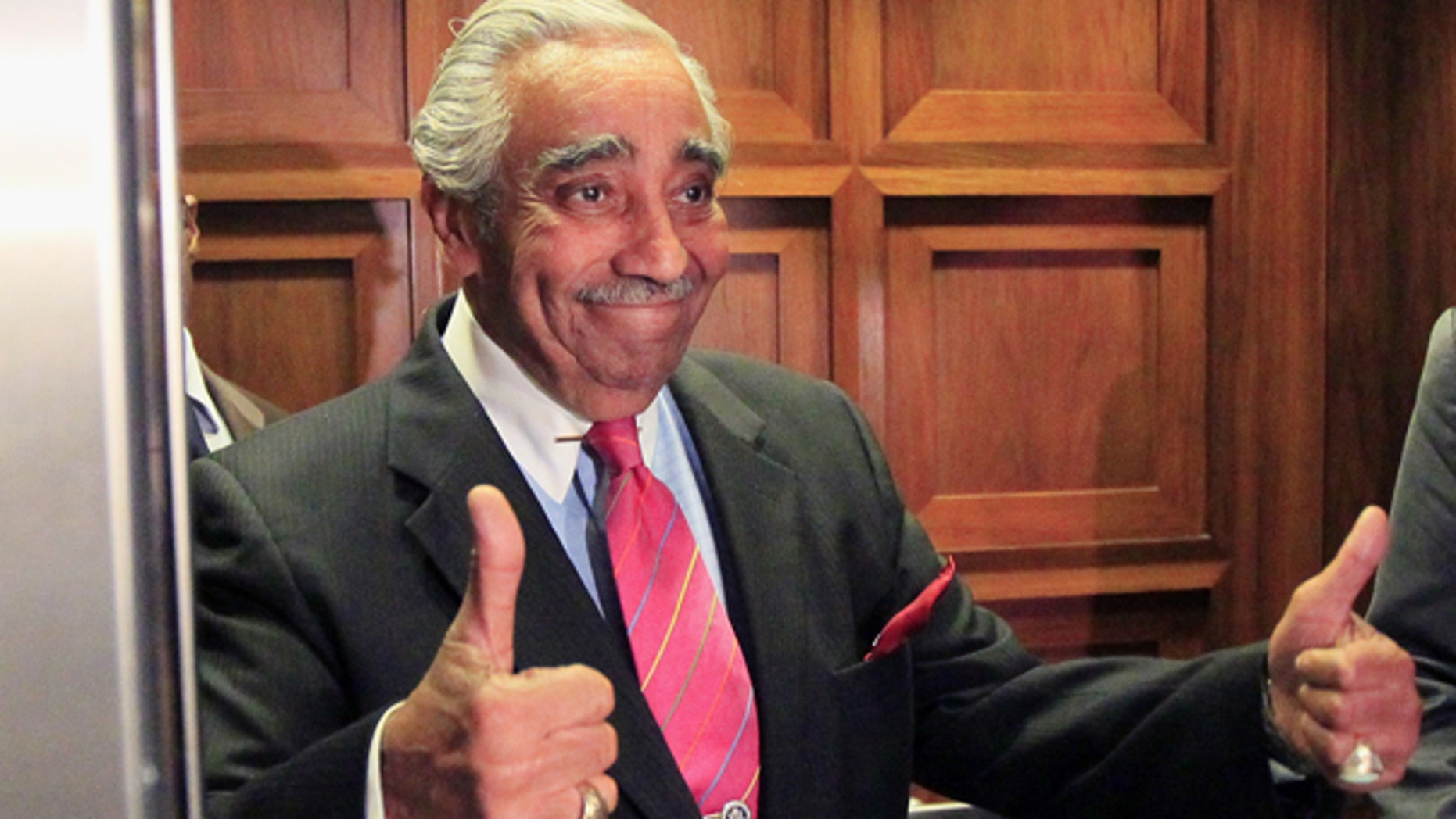 July 28: Rep. Charles Rangel, D-N.Y., gives thumbs up as he gets in the elevator to leave his office for a vote on Capitol Hill in Washington. (AP)