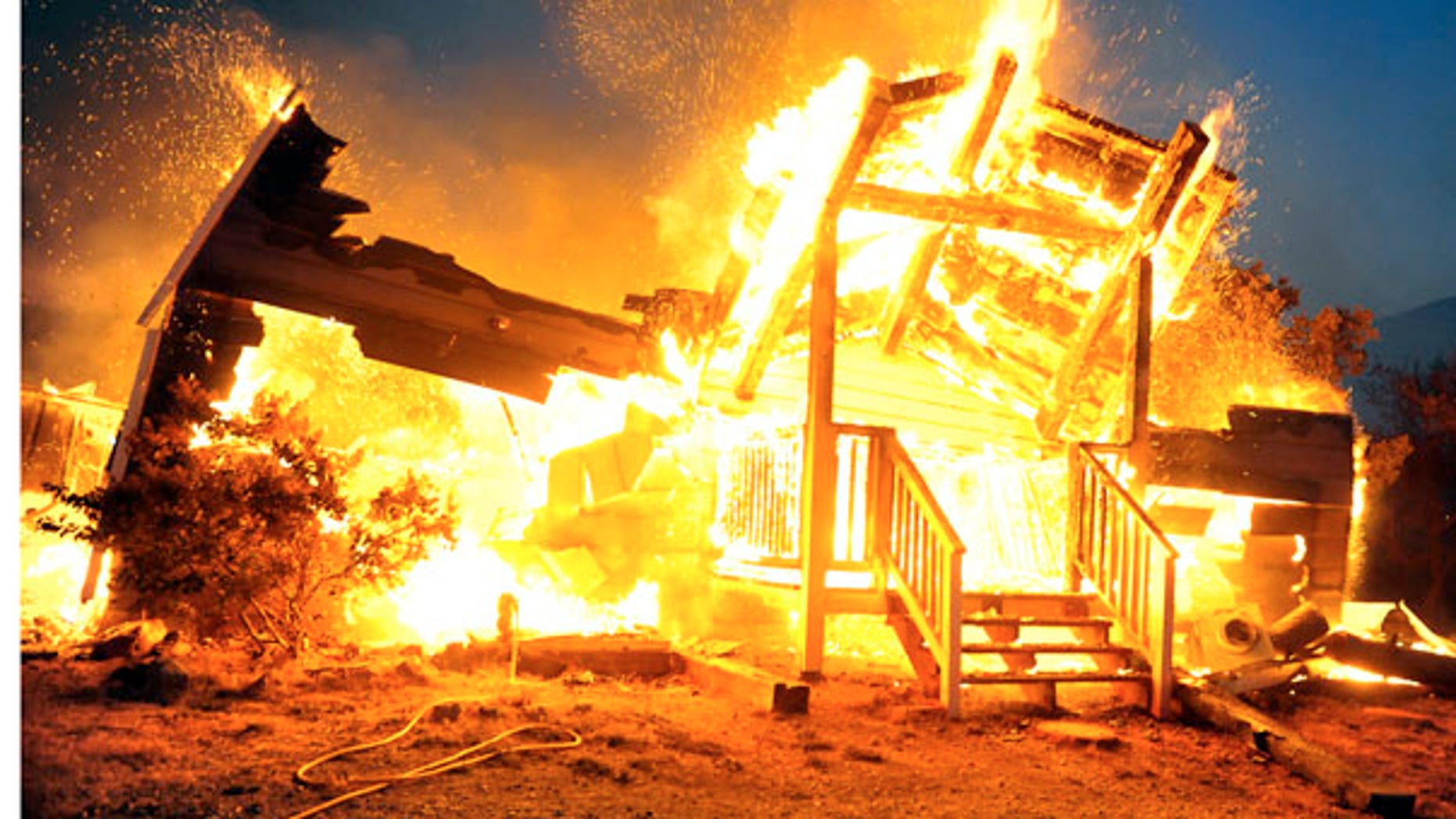 July 27: A house in Tehachapi, Calif., burns as two wildfires erupted and spread quickly in Southern California, destroying dozens of homes and forcing evacuations in remote areas of the state's Kern County.