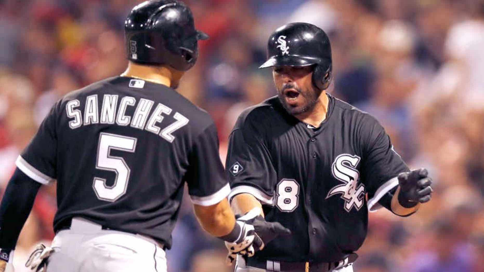 Jul 28, 2015; Boston, MA, USA; Chicago White Sox catcher Geovany Soto (58) is congratulated second baseman Carlos Sanchez (5) after hitting a home run during the seventh inning at Fenway Park. Mandatory Credit: Greg M. Cooper-USA TODAY Sports