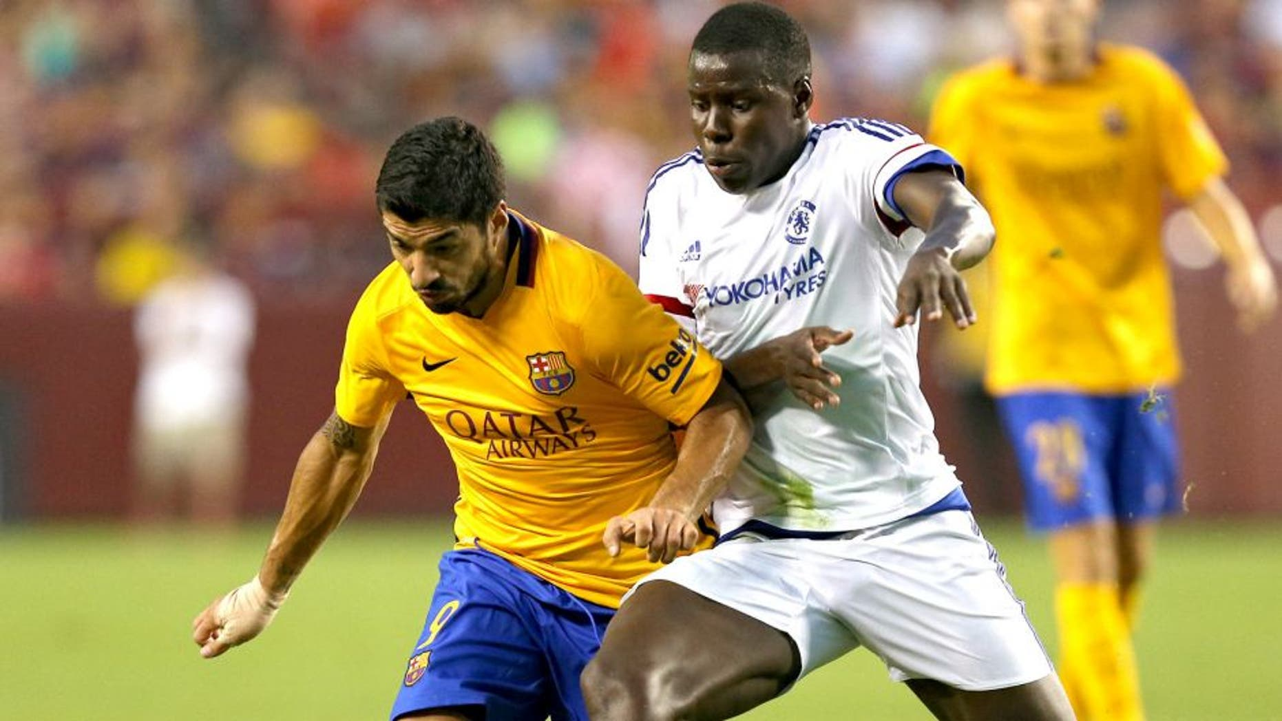 LANDOVER, MD - JULY 28: Luis Suarez #9 of Barcelona battles with Kurt Zouma #5 of Chelsea in the first half during the International Champions Cup North America at FedExField on July 28, 2015 in Landover, Maryland. (Photo by Patrick Smith/Getty Images)