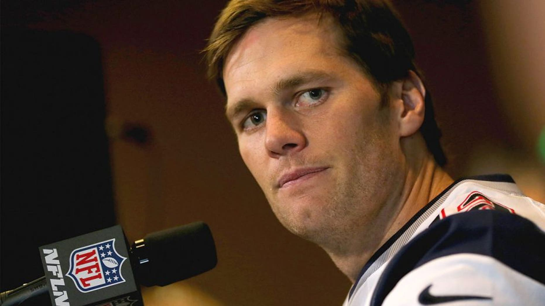 CHANDLER, AZ - JANUARY 28: Quarterback Tom Brady #12 of the New England Patriots speaks with the media on January 28, 2015 in Chandler, Arizona. (Photo by Elsa/Getty Images)
