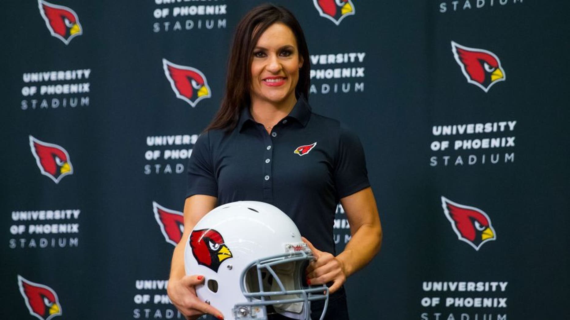 Jul 28, 2015; Tempe, AZ, USA; Arizona Cardinals inside linebackers intern and preseason coach Jen Welter holds a helmet as she poses for a photo during a press conference at the teams training facility. Mandatory Credit: Mark J. Rebilas-USA TODAY Sports