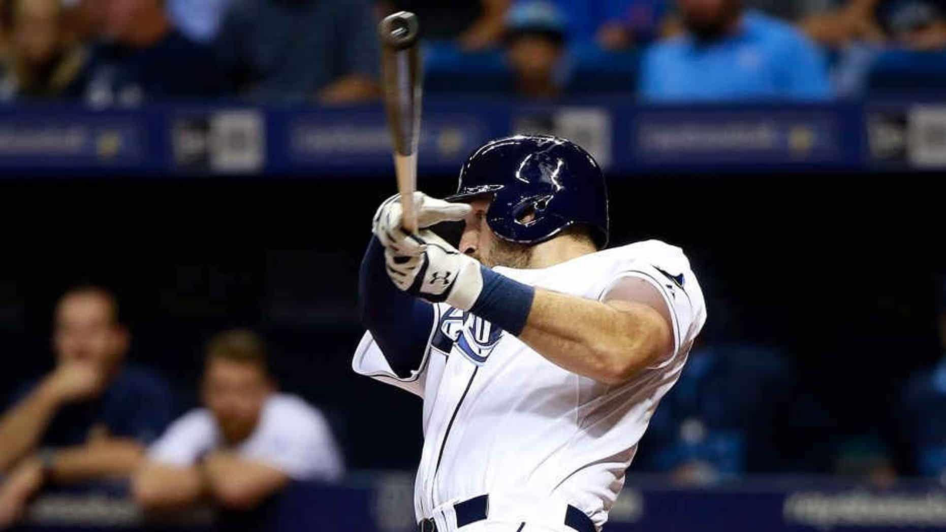 Jul 28, 2015; St. Petersburg, FL, USA; Tampa Bay Rays catcher Curt Casali (19) hits a two-run home run during the fourth inning against the Detroit Tigers at Tropicana Field. Mandatory Credit: Kim Klement-USA TODAY Sports