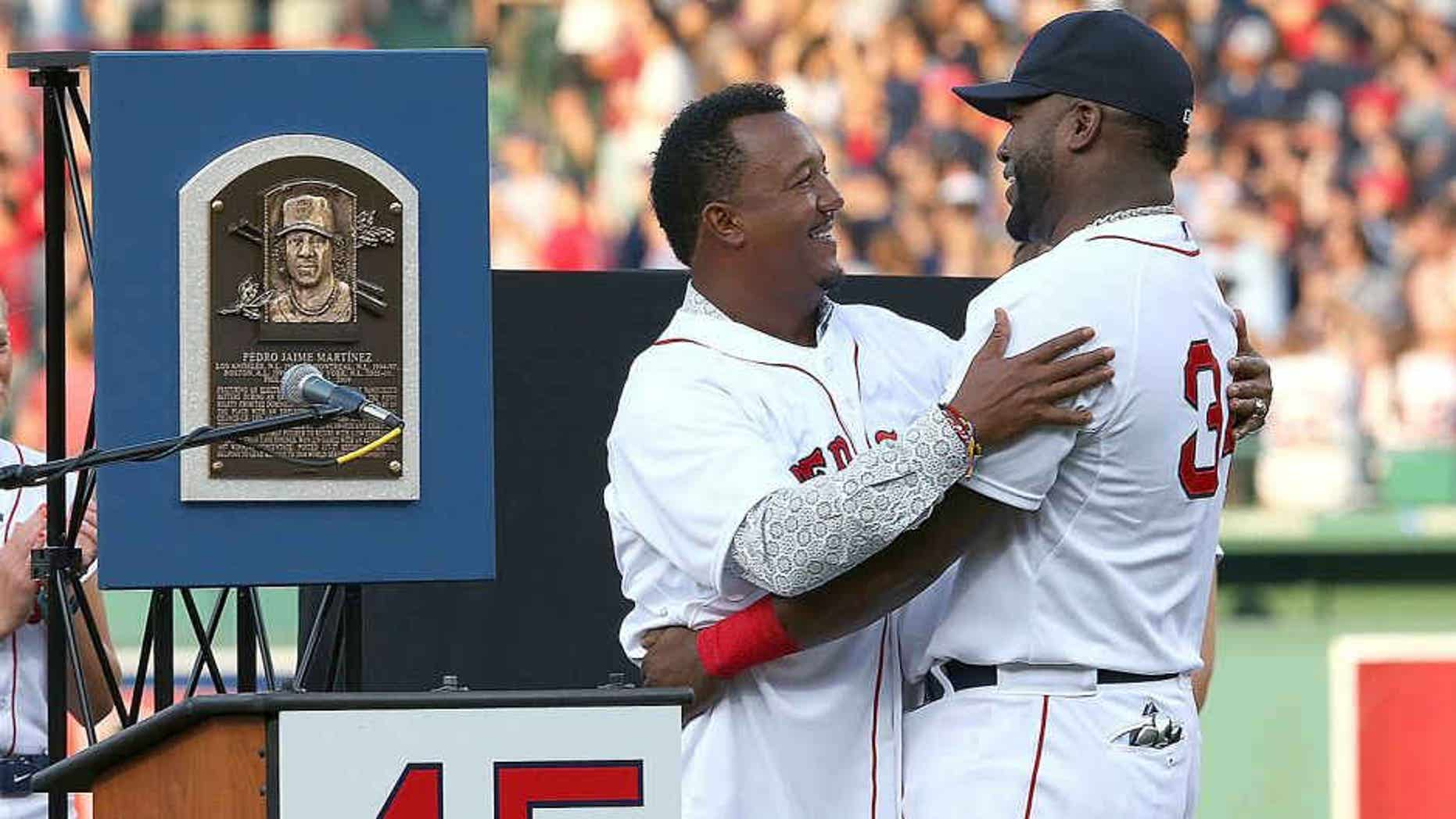 BOSTON, MA - JULY 28: David Ortiz #34 of the Boston Red Sox hugs Pedro Martinez, a former member of the Boston Red Sox, during a ceremony to retire Martinez's number 45 before a game with the Chicago White Sox at Fenway Park on July 28, 2015 in Boston, Massachusetts. (Photo by Jim Rogash/Getty Images)