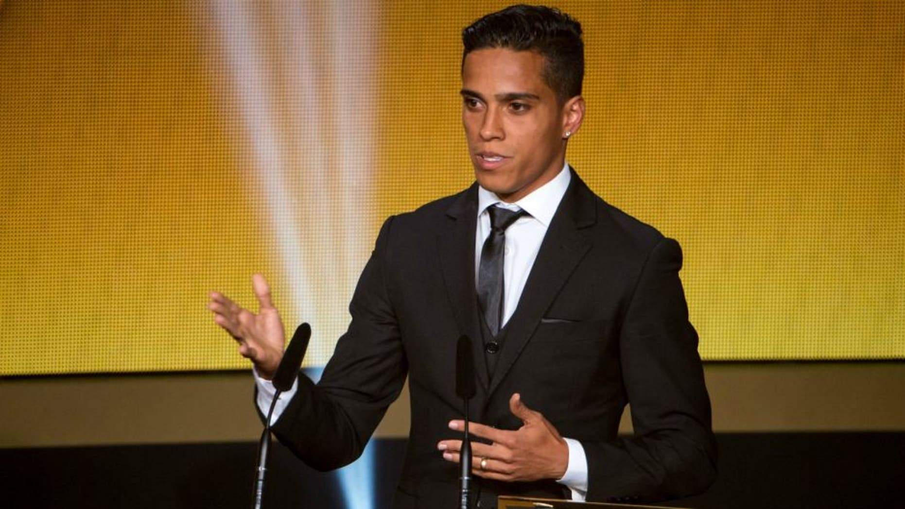 ZURICH, SWITZERLAND - JANUARY 11: FIFA Puskas Award for the best goal winner Wendell Lira of Brazil and Vila Nova arrives on stage to deliver a speech during the FIFA Ballon d'Or Gala 2015 at the Kongresshaus on January 11, 2016 in Zurich, Switzerland. (Photo by Philipp Schmidli/Getty Images)