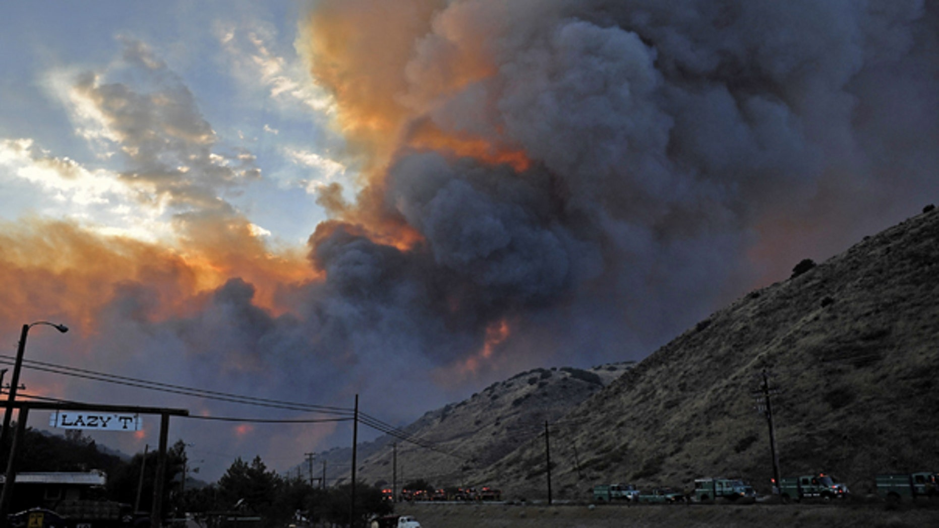 July 29: A fast moving wildfire burns above Elizabeth Lake Road in Leona Valley near Palmdale, Calif. Mandatory evacuations were issued for the community of Leona Valley on Thursday evening, an L.A. County fire inspector said. (AP)