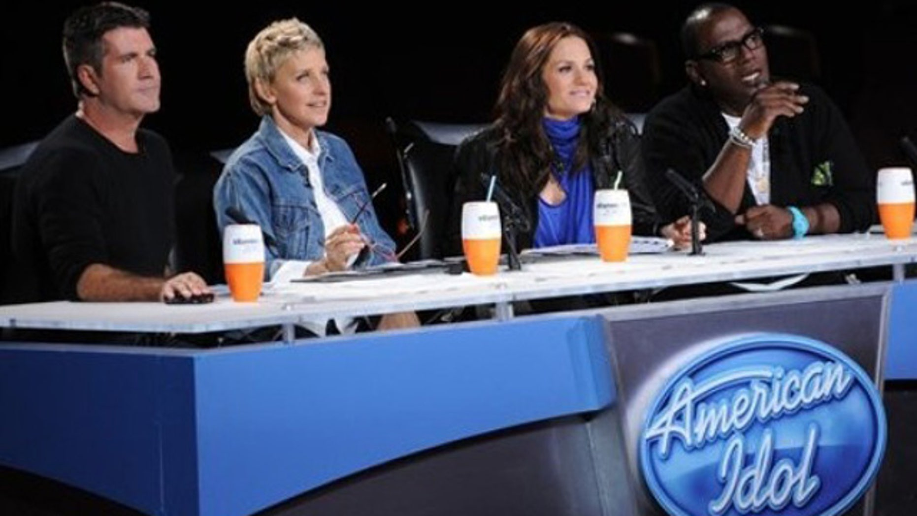 """In this undated publicity image released by Fox, """"American Idol"""" judges, from left, Simon Cowell,  Ellen DeGeneres, Kara DioGuardi and Randy Jackson are shown."""