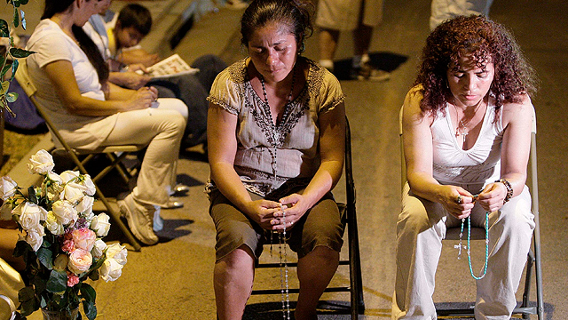 Women pray as they join dozens attending an overnight vigil at the Arizona Capitol late Wednesday in Phoenix, only hours after portions of Arizona's new immigration law, S.B. 1070, was blocked by a federal judge.