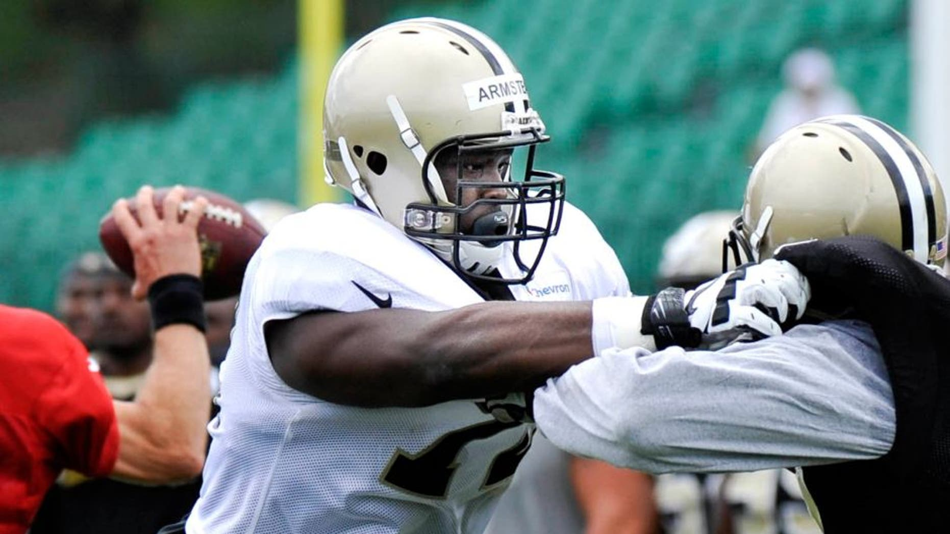 Jul 28, 2014; White Sulpher Springs, WV, USA; New Orleans Saints tackle Terron Armstead (72) blocks defensive end Cameron Jordan (94) during training camp at The Greenbrier. Mandatory Credit: Michael Shroyer-USA TODAY Sports