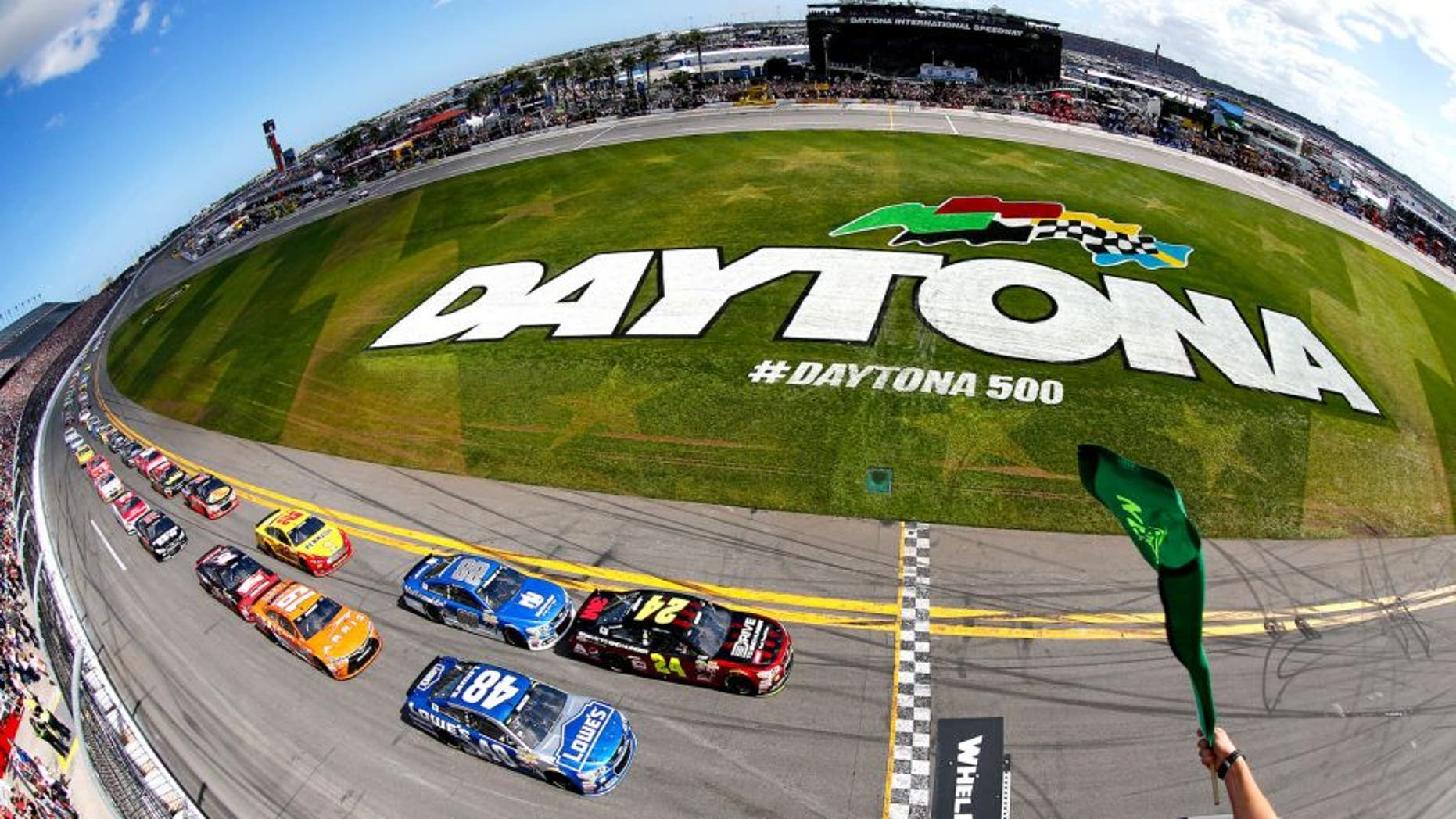 DAYTONA BEACH, FL - FEBRUARY 22: Jeff Gordon, driver of the #24 Drive To End Hunger Chevrolet, and Jimmie Johnson, driver of the #48 Lowe's Chevrolet, lead the field to the green flag for the running of the NASCAR Sprint Cup Series 57th Annual Daytona 500 at Daytona International Speedway on February 22, 2015 in Daytona Beach, Florida. (Photo by Jonathan Ferrey/NASCAR via Getty Images)