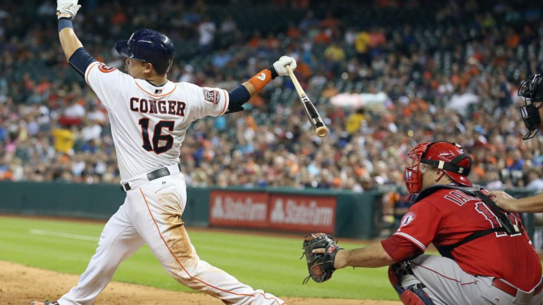 Jul 28, 2015; Houston, TX, USA; Houston Astros catcher Hank Conger (16) hits a double against the Los Angeles Angels in the sixth inning at Minute Maid Park. Astros won 10-5. Mandatory Credit: Thomas B. Shea-USA TODAY Sports