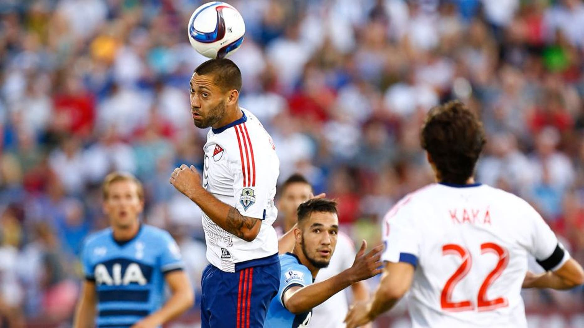 Jul 29, 2015; Denver, CO, USA; MLS All Stars forward Clint Dempsey (2) of the Seattle Sounders FC heads the ball during the first half of the 2015 MLS All Star Game against the Tottenham Hotspur at Dick's Sporting Goods Park. Mandatory Credit: Isaiah J. Downing-USA TODAY Sports