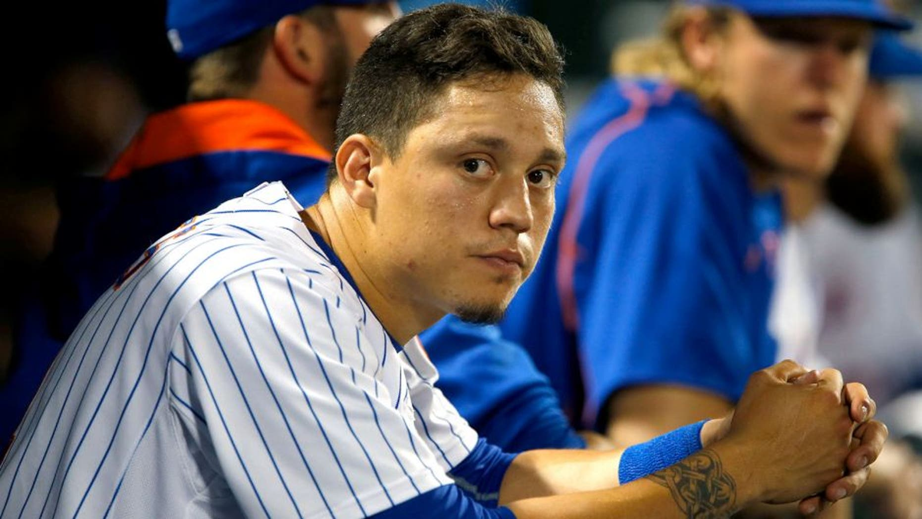 Jul 29, 2015; New York City, NY, USA; New York Mets shortstop Wilmer Flores (4) dejected in the dugout during game against the San Diego Padres at Citi Field. Mandatory Credit: Noah K. Murray-USA TODAY Sports