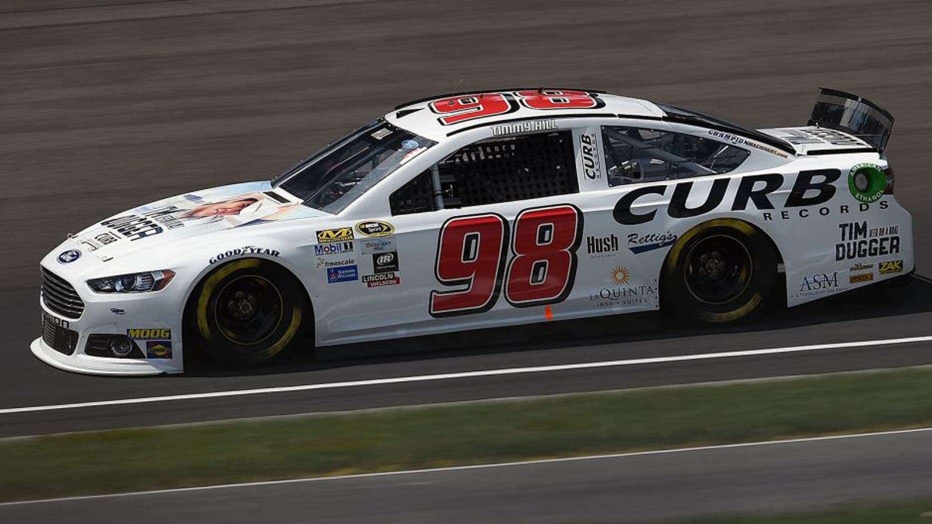 INDIANAPOLIS, IN - JULY 24: Timmy Hill, driver of the #98 Curb Records Ford, practices for the NASCAR Sprint Cup Series Crown Royal Presents the Jeff Kyle 400 at the Brickyard at Indianapolis Motorspeedway on July 24, 2015 in Indianapolis, Indiana. (Photo by Rainier Ehrhardt/NASCAR via Getty Images)
