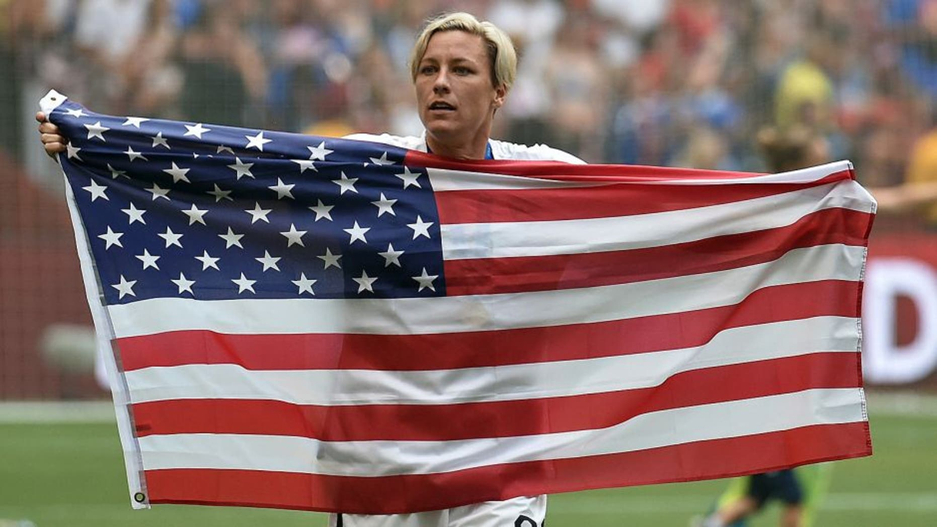 VANCOUVER, BC - JULY 05: Abby Wambach #20 of the United States celebrates the 5-2 victory against Japan in the FIFA Women's World Cup Canada 2015 Final at BC Place Stadium on July 5, 2015 in Vancouver, Canada. (Photo by Rich Lam/Getty Images)