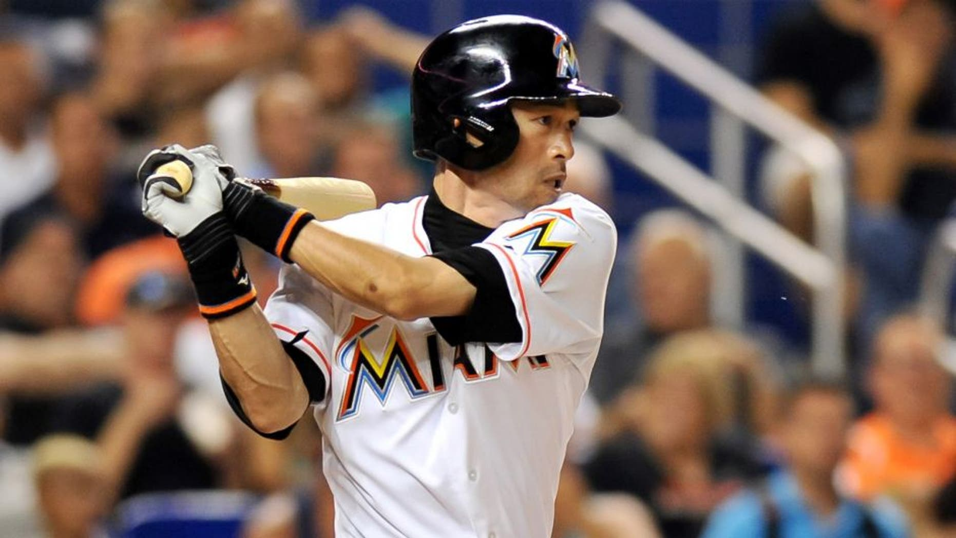 Jul 28, 2015; Miami, FL, USA; Miami Marlins left fielder Ichiro Suzuki (51) connects for a base hit during the fifth inning against the Washington Nationals at Marlins Park. Mandatory Credit: Steve Mitchell-USA TODAY Sports