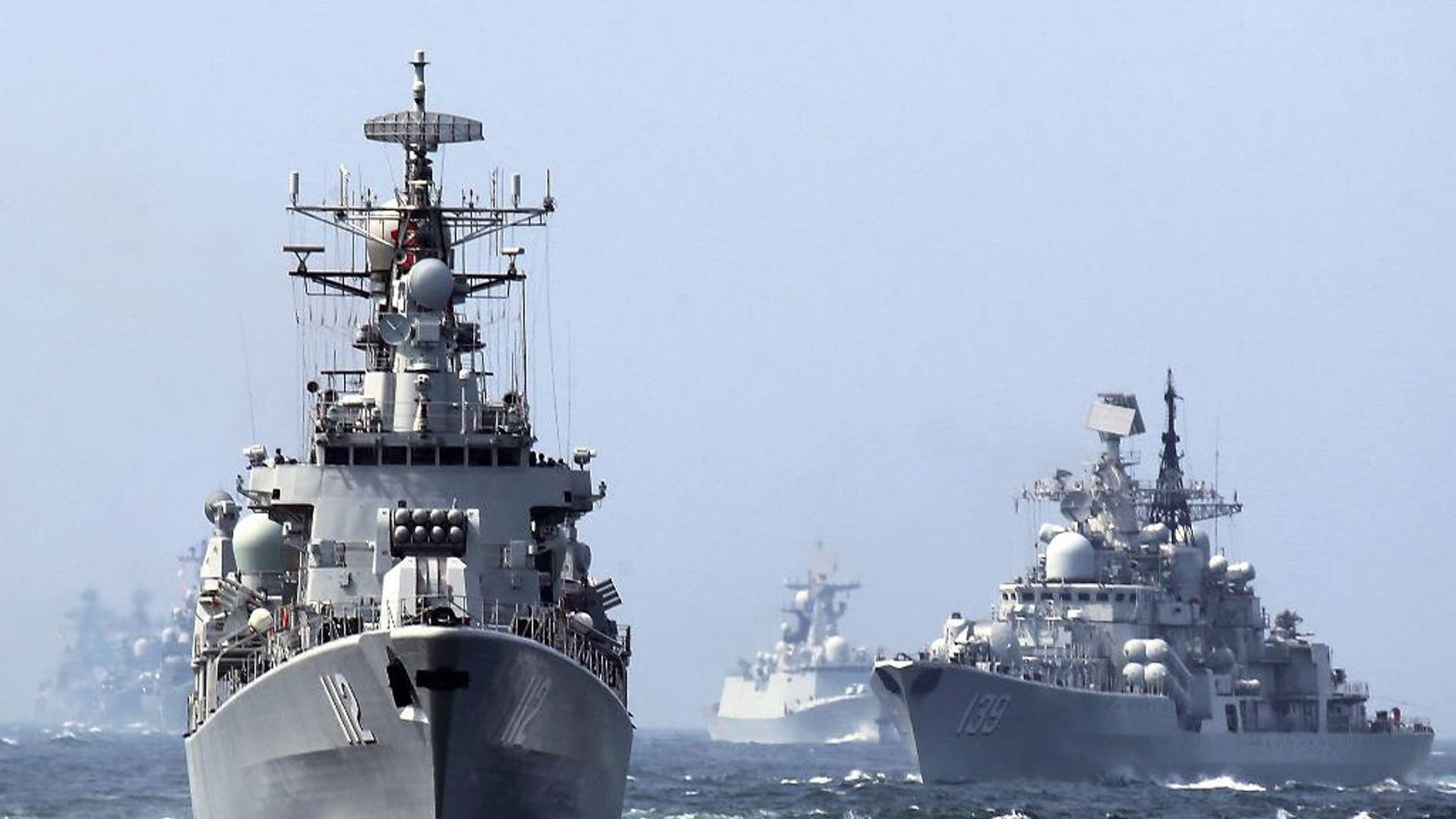 "In this May 24, 2014, file photo, China's Harbin (112) guided missile destroyer and DDG-139 Ningbo Sovremenny class Type-956EM destroyer, right, take part in a week-long China-Russia ""Joint Sea-2014"" navy exercise at the East China Sea off Shanghai, China. A Chinese navy task force wrapped up visits to four Persian Gulf states as the increasingly capable maritime force grows its presence in the strategically vital region. The three ships, including Harbin, departed Kuwait on Sunday, Feb. 5, 2017, after stopping in Saudi Arabia, Qatar and the United Arab Emirates, the Defense Ministry said on its website Monday, Feb. 6, 2017. (Chinatopix via AP)"