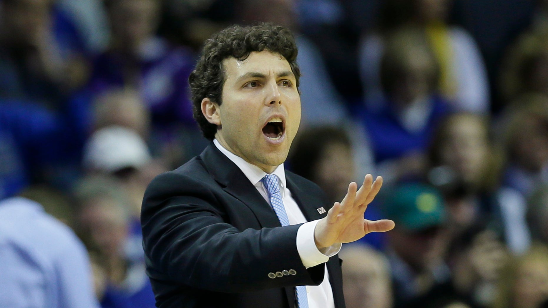 Memphis coach Josh Pastner shouts to players in the second half of an NCAA college basketball game against Central Florida in Memphis, Tenn., Wednesday, Feb. 12, 2014. Memphis defeated UCF 76-70. (AP Photo/Danny Johnston)