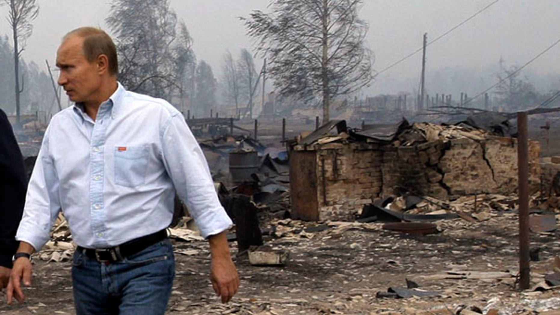 July 30: Russian Prime Minister Vladimir Putin tours the village of Verkhnyaya Vereya, where all 341 houses have burned to the ground.