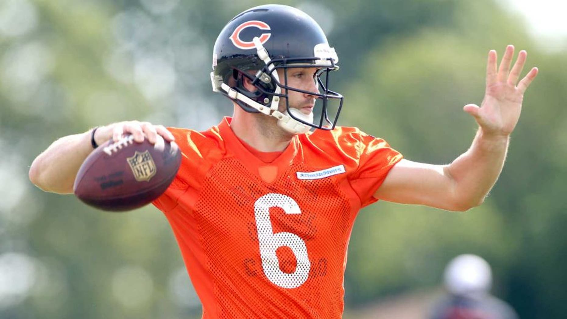 Jul 25, 2014; Chicago, IL, USA; Chicago Bears quarterback Jay Cutler throws a pass during training camp at Olivet Nazarene University. Mandatory Credit: Jerry Lai-USA TODAY Sports