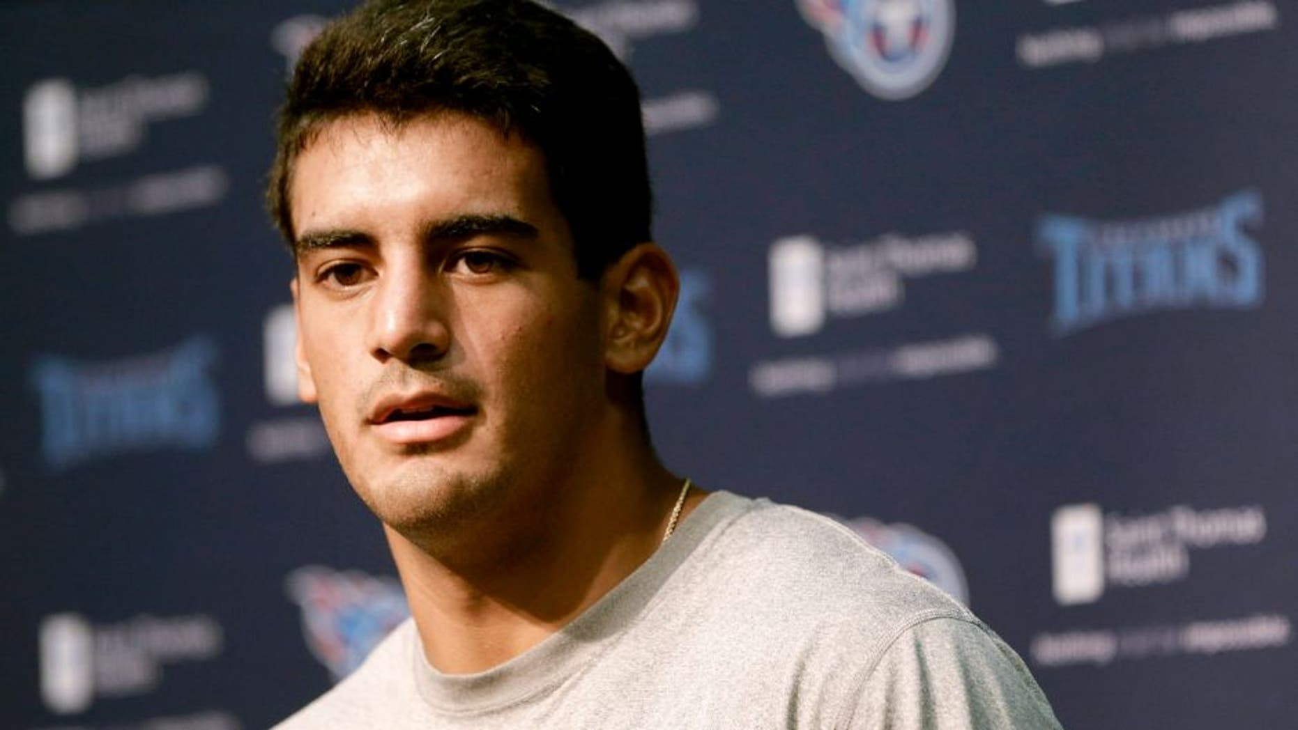 Tennessee Titans quarterback Marcus Mariota answers a question during a news conference Thursday, July 30, 2015, in Nashville, Tenn. The Titans begin NFL football training camp Friday. (AP Photo/Mark Humphrey)