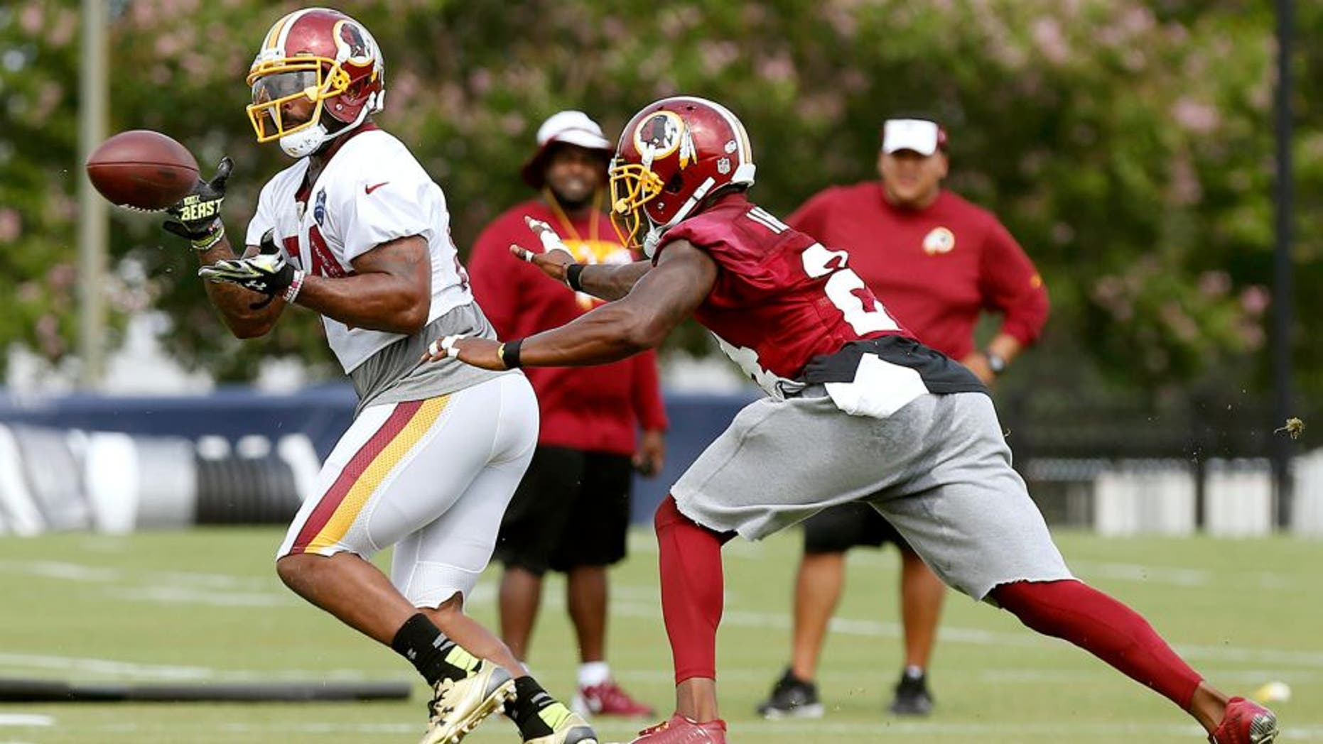 Jul 30, 2015; Richmond, VA, USA; Washington Redskins tight end Niles Paul (84) catches the ball in front of Redskins defensive back Duke Ihenacho (24) during drills as part of afternoon practice on day one of training camp at the Washington Redskins Bon Secours Training Center. Mandatory Credit: Geoff Burke-USA TODAY Sports