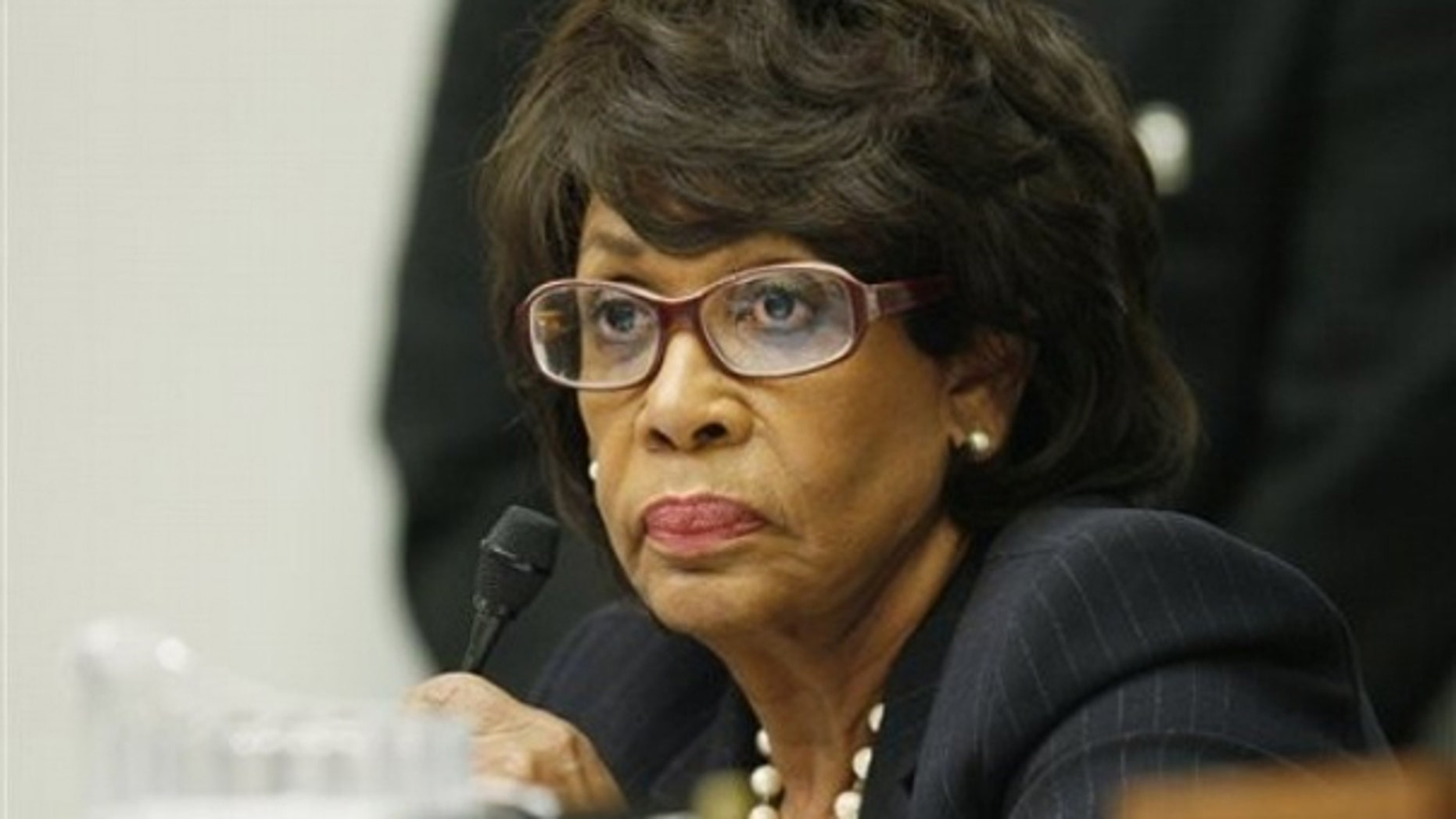 In this file photo, Rep. Maxine Waters is seen on Capitol Hill in Washington as she questions witnesses during a hearing on legal issues relating to football head injuries.