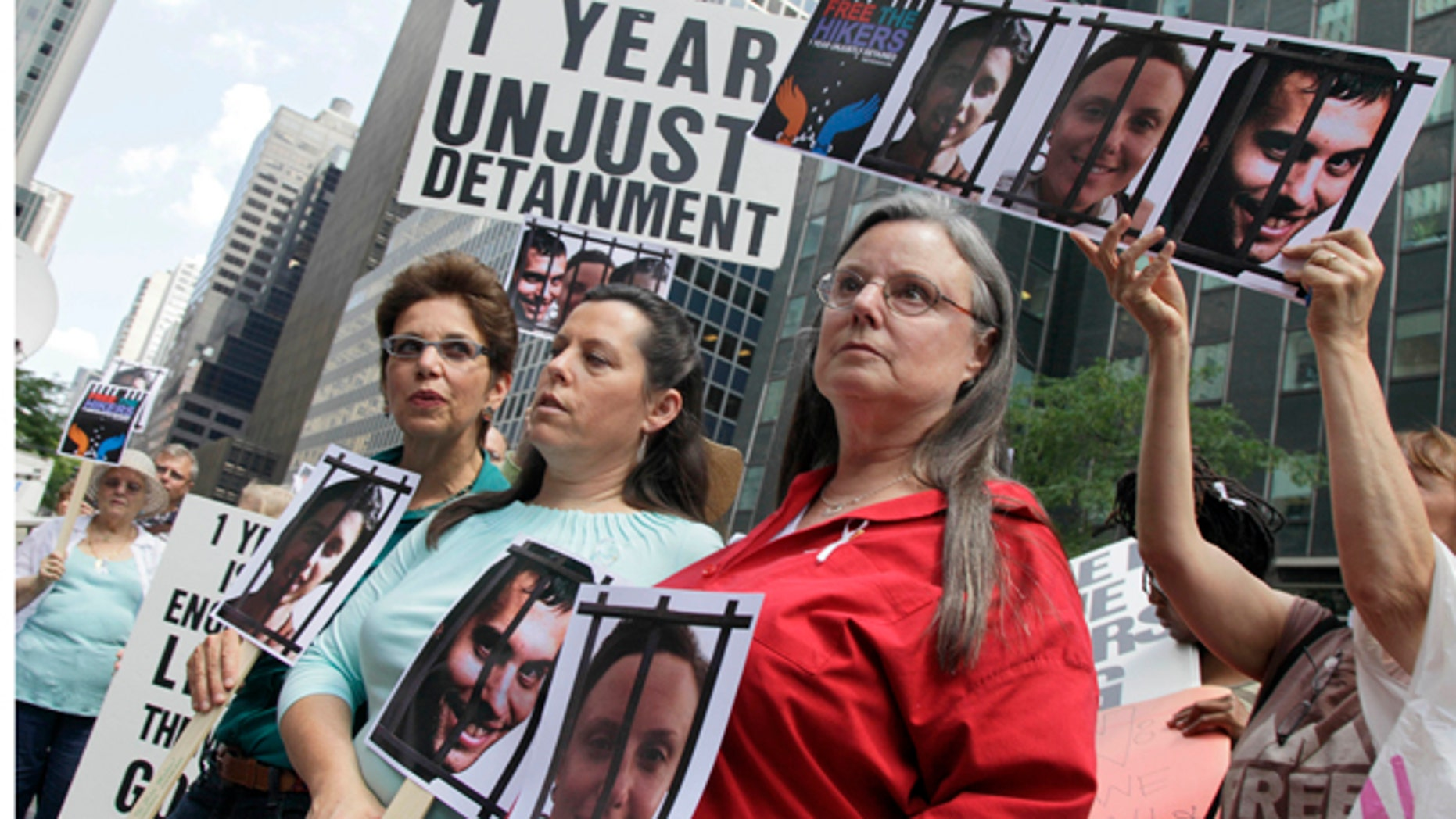 Laura Fattal, left, Cindy Hickey, center, and Nora Shourd, mothers of three American hikers jailed in Iran, participate in a demonstration outside Iran's mission to the United Nations, in New York,  Friday, July 30, 2010. Saturday marks a year since the hikers were arrested along the Iraqi border. (AP Photo/Richard Drew)