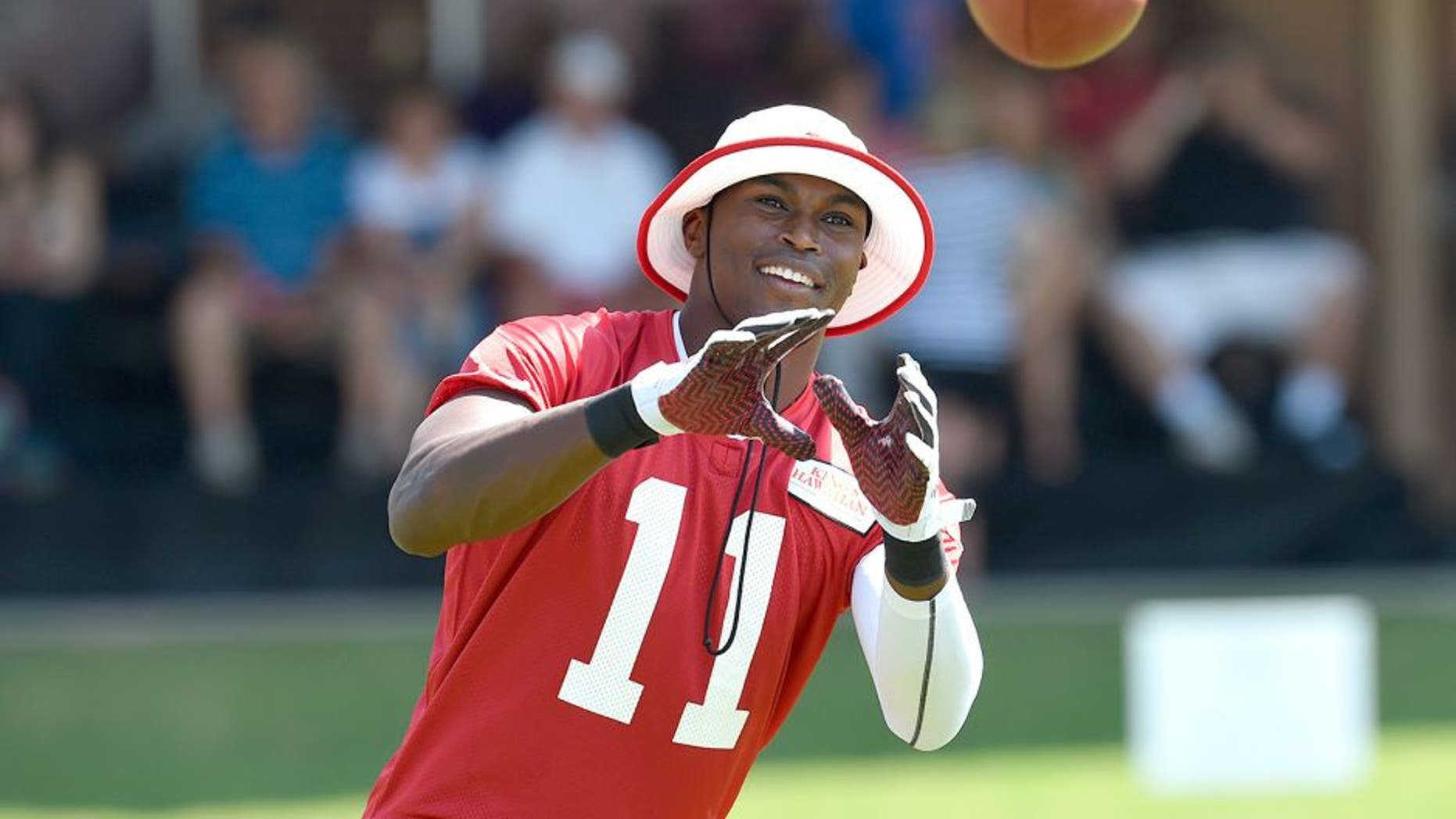 Jul 26, 2014; Atlanta, GA, USA; Atlanta Falcons wide receiver Julio Jones (11) reacts while catching passes on the field during training camp at Falcons Training Complex. Mandatory Credit: Dale Zanine-USA TODAY Sports